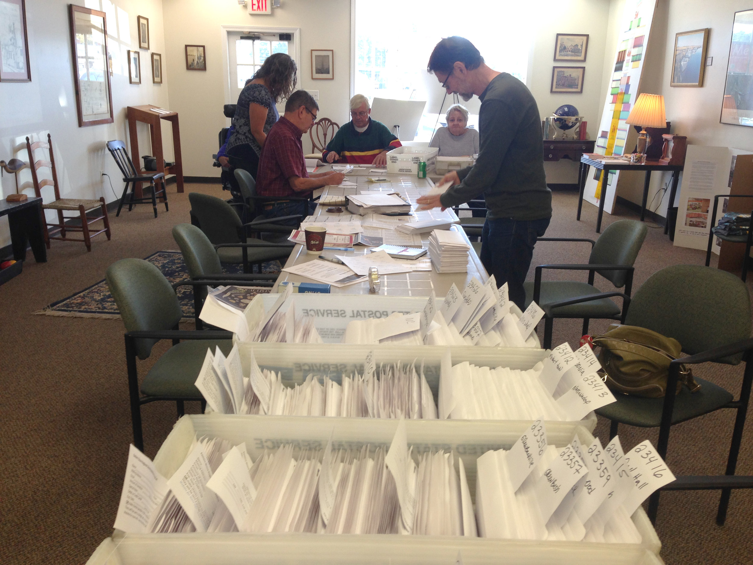 ESPL Foundation volunteers stuff envelopes for a capital campaign mailing.
