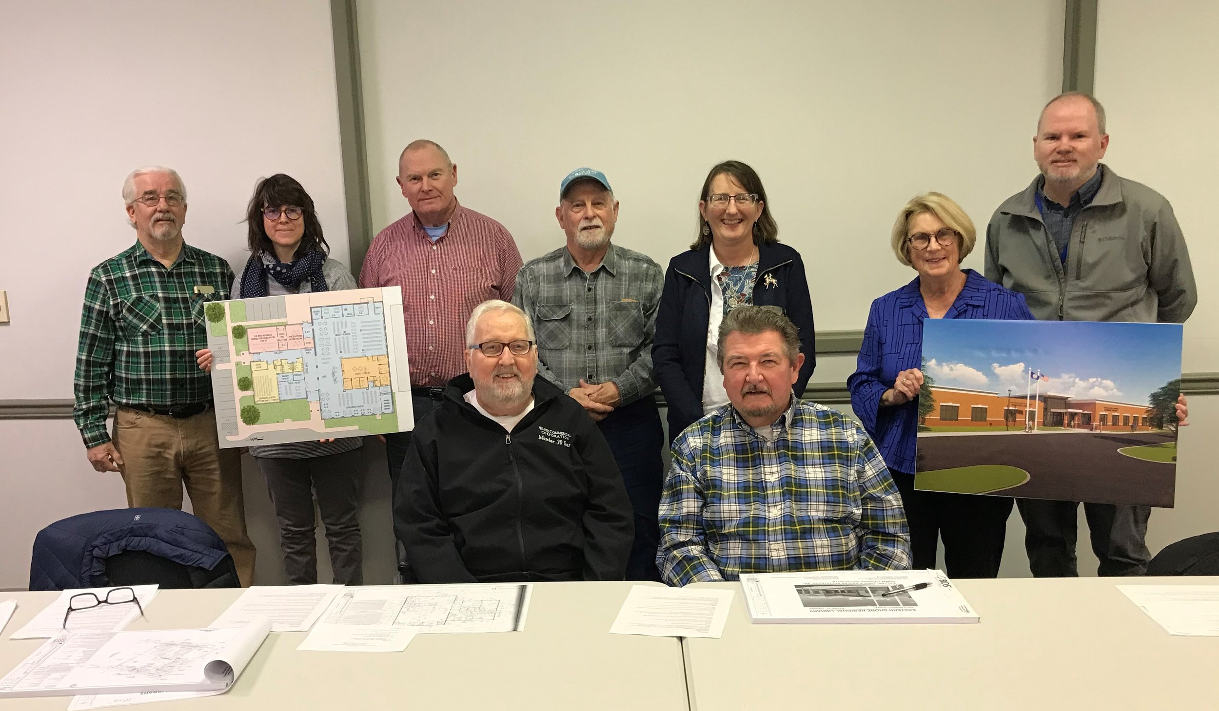 The library's Construction Committee and the project Steering Committee recently met to approve the construction plans. Pictured left to right: Tom Rakowski, Charle Ricci, Dennis Custis, Richard Lewis, Supervisor Paul Muhly, Cara Burton, Tim Valentine, Pam Holley, and Stewart Hall.