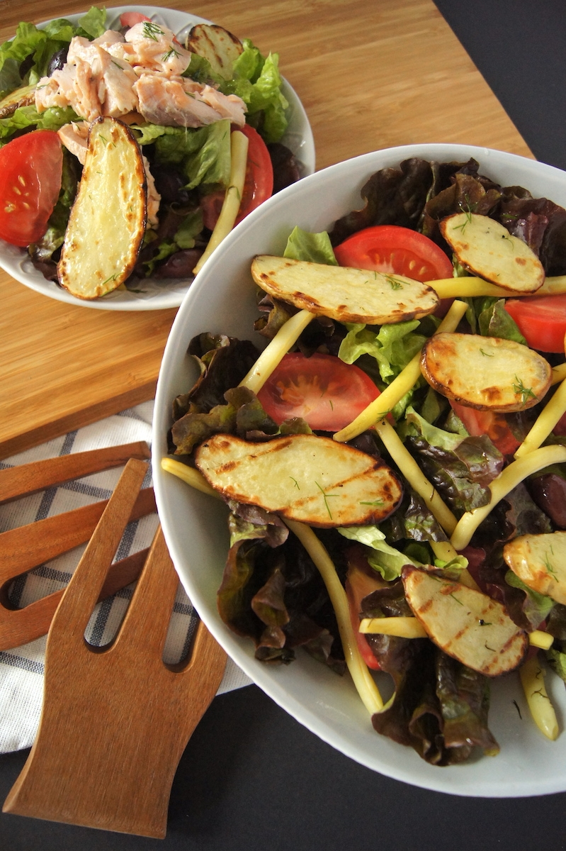 Grilled Potato Niciose-Style Salad. This Grilled Potato Niçoise-Style Salad is an easy recipe and healthy summer meal that is a perfect outdoor BBQ dinner idea for busy families! Warmer summer nights has our family cooking dinner recipes outside! This is a quick & easy dinner that allows the potatoes to cook in under 8 minutes by slicing them thinly. The Carisma potatoes by EarthFresh really shine in taste and texture for this grilled salad family meal.