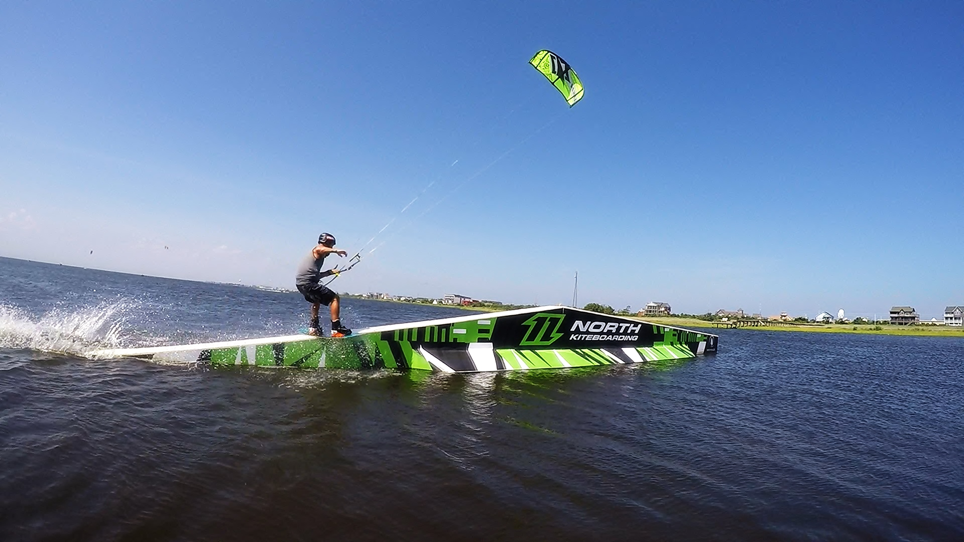 Kiteboarding freestyle on North slider with Naish gear