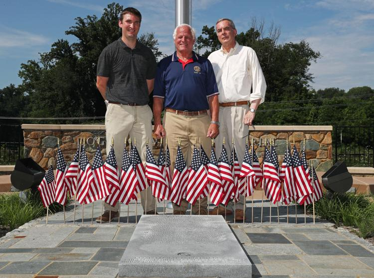 Matt Deegan (from left), project coordinator with ParadeRest, Bruce Eades, president of the Dogwood Memorial Foundation, and Gregory Saathoff, co-founder of ParadeRest, stand near the Charlottesville Dogwood Vietnam Memorial.