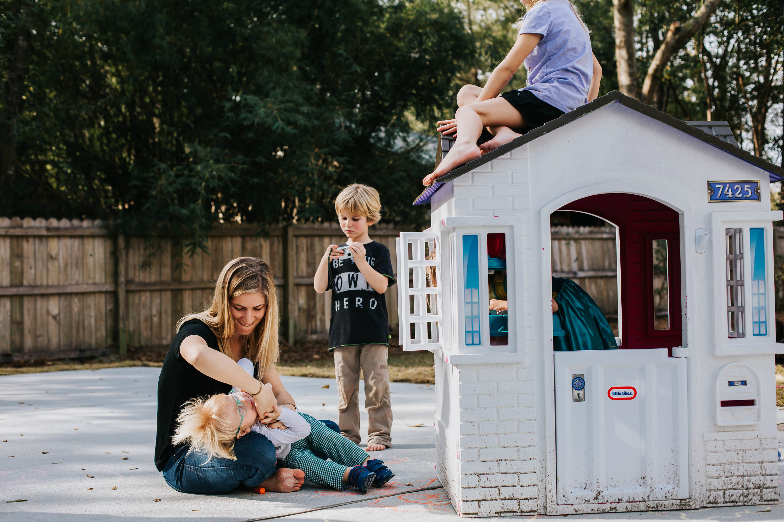 Fairhope Mom playing with children in backyard