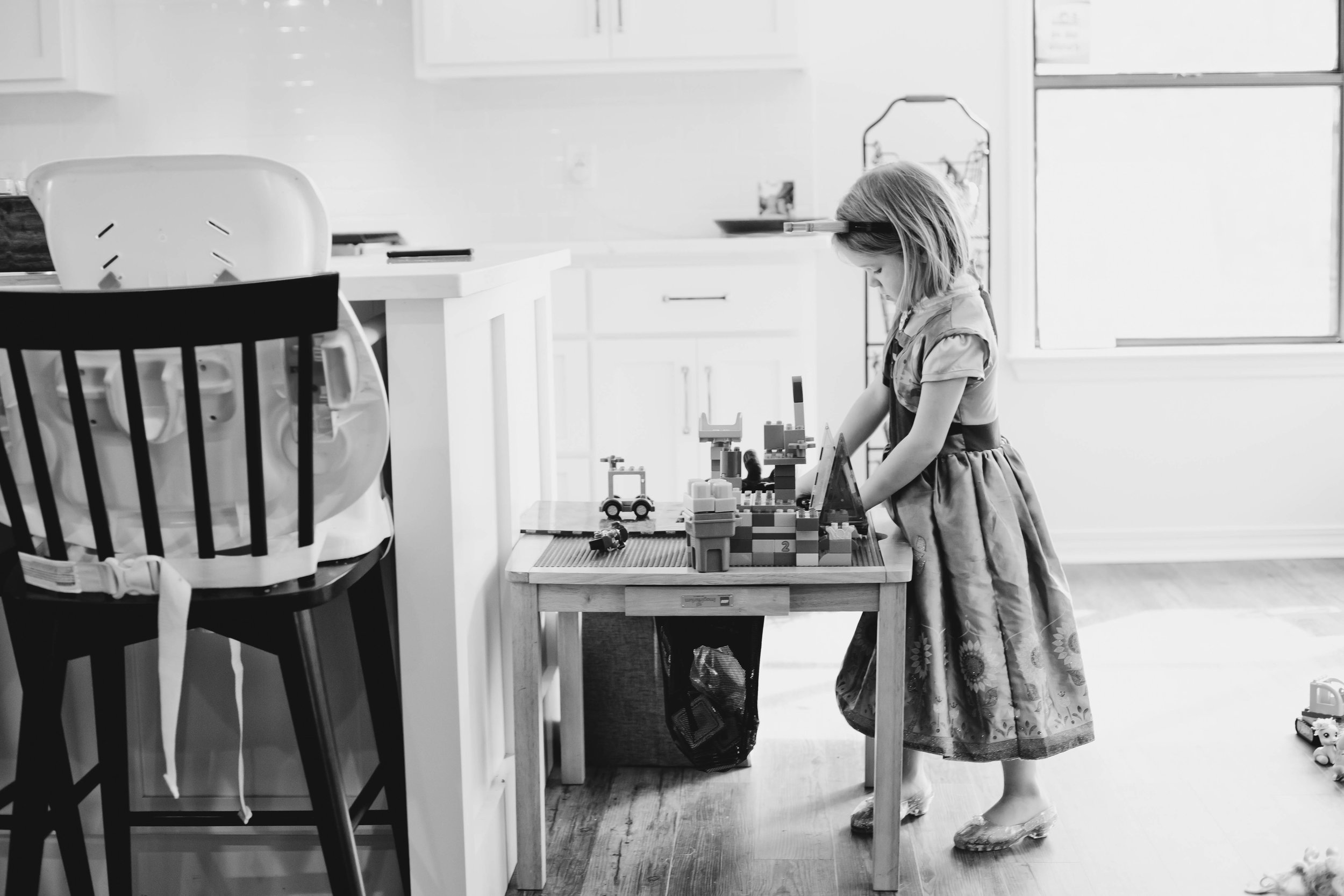 girl playing dress up in home family session Fairhope Alabama