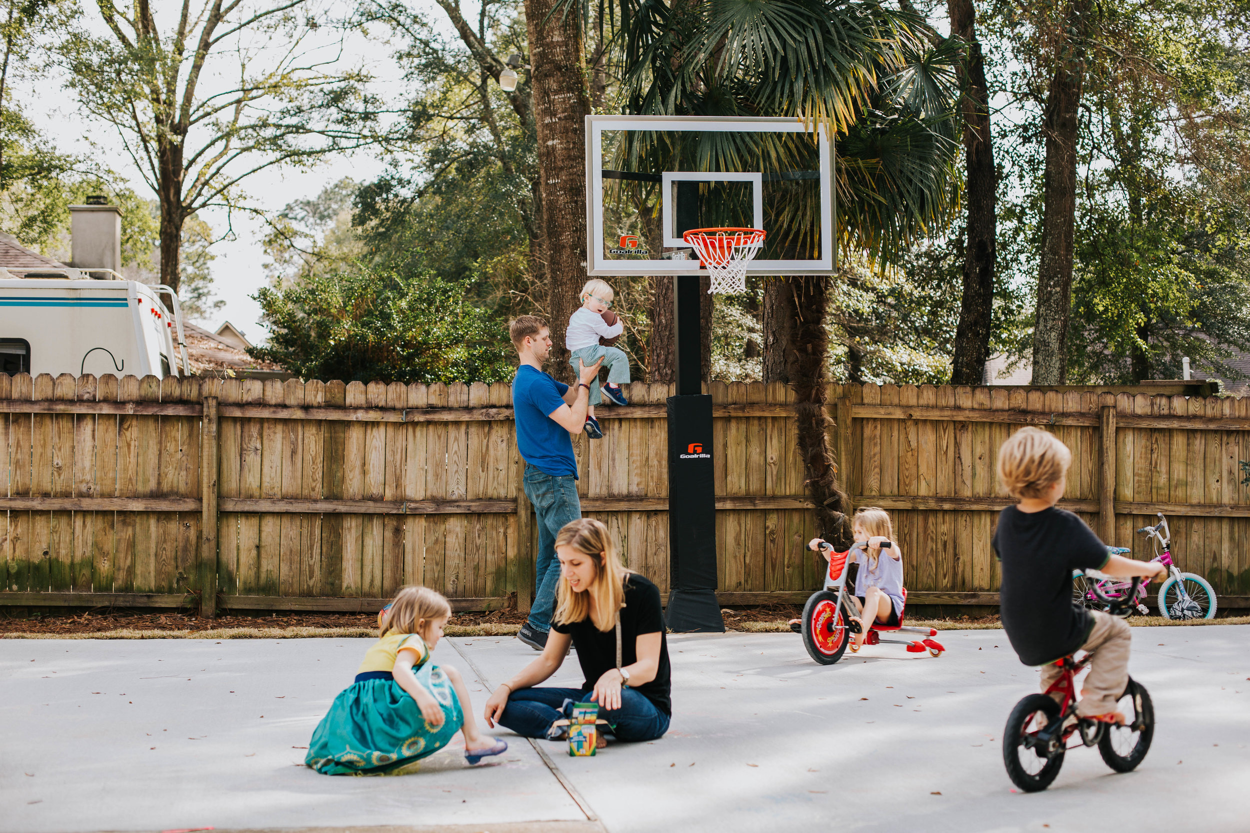 Fairhope Alabama Family playing in Backyard