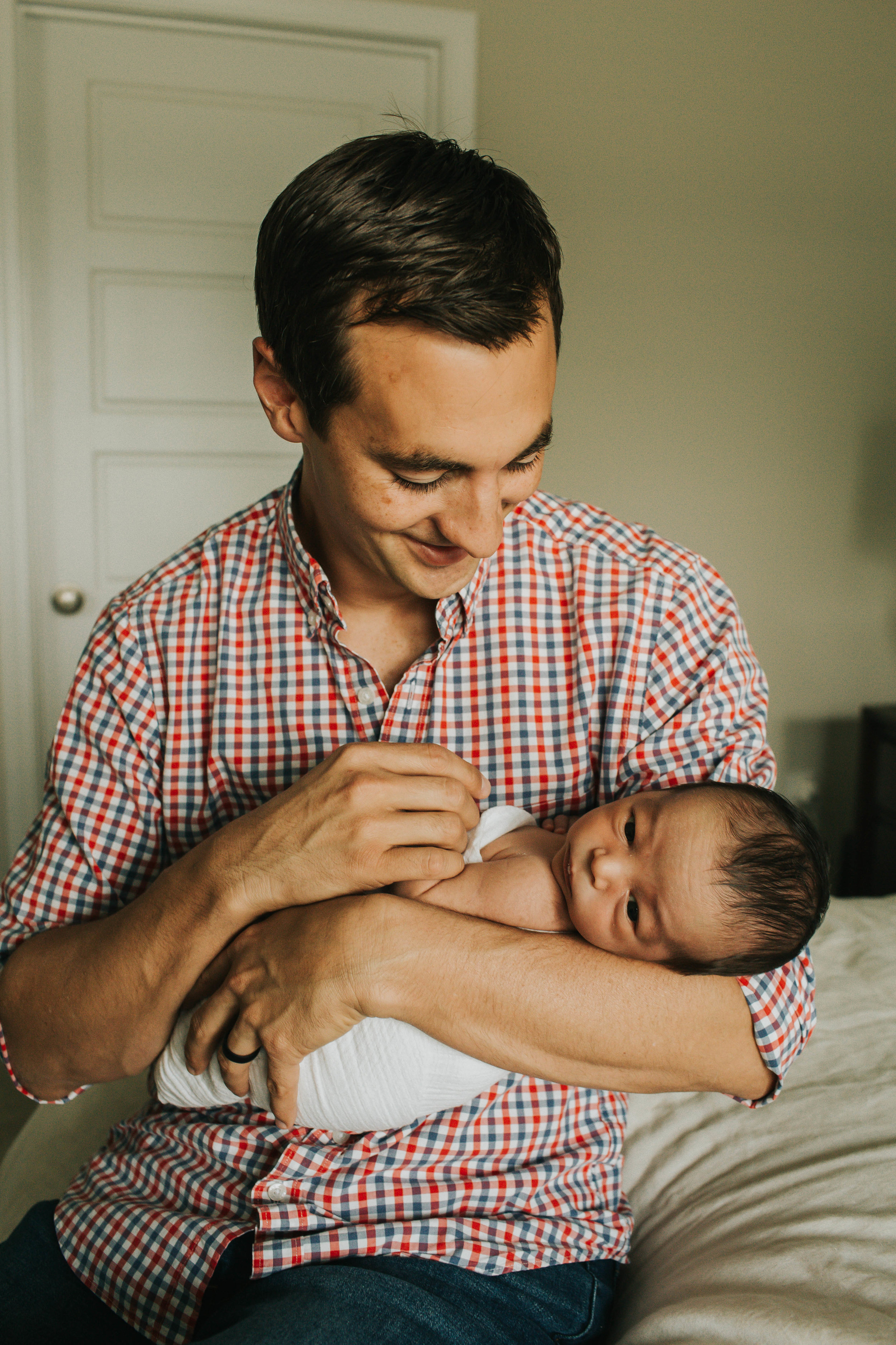 daddy holding baby  | Fairhope Newborn - Caitlen Babb Photography