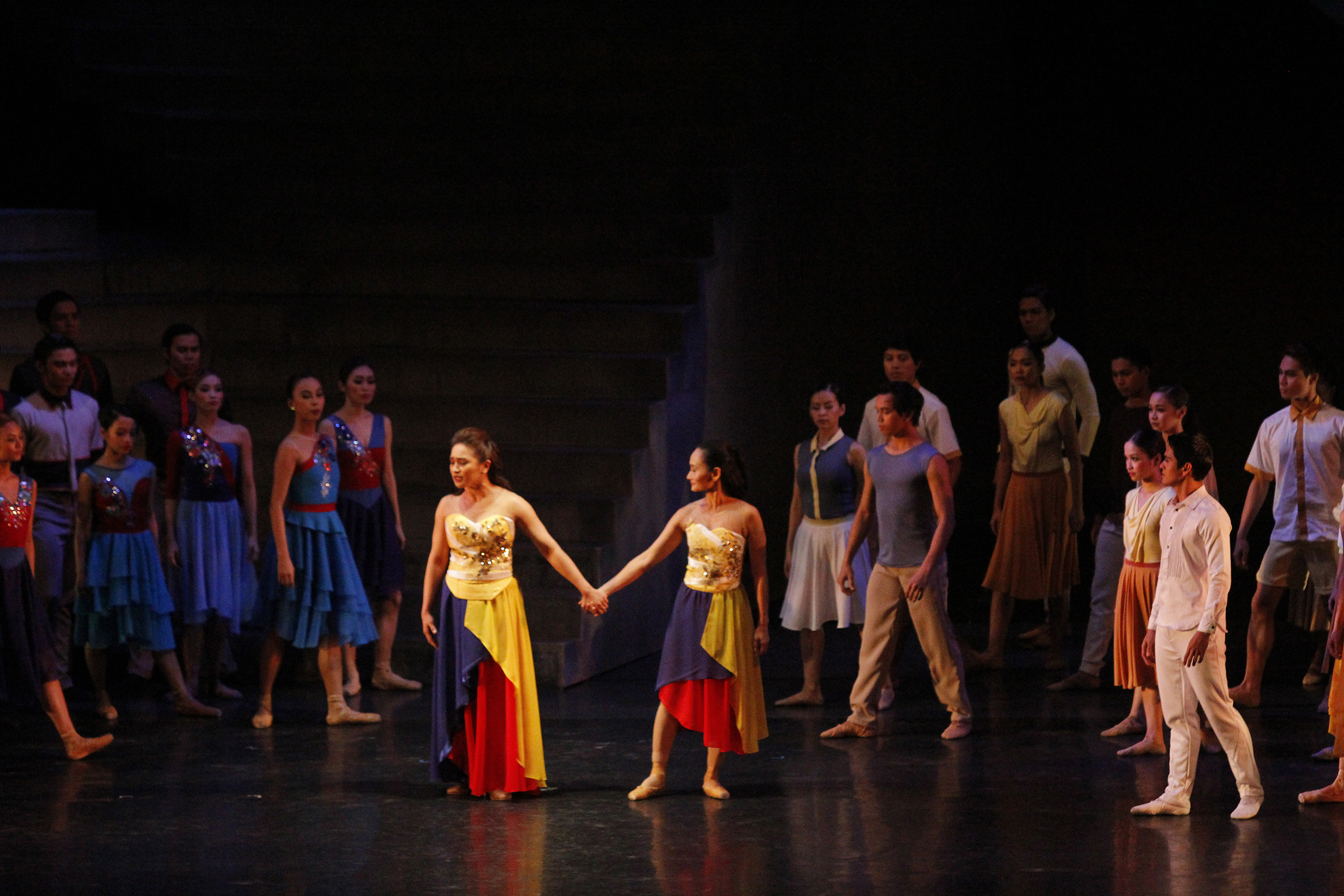 Inang Bayan, represented by Lisa Macuja-Elizalde (dance) and Joanna Ampil (song), is appropriately swathed in the colors of the Philippine flag.