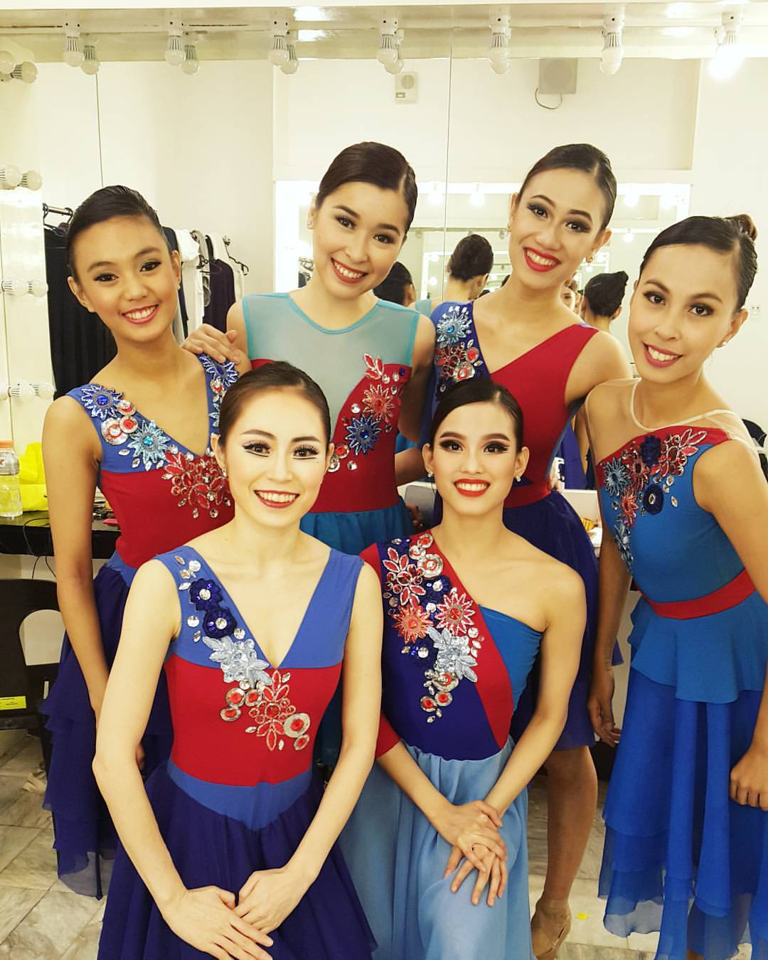 In some performances of    Rebel   , Abi (standing, third from left) was one of Imelda's Blue Ladies, along with (standing, from left) Henrietta Garcia, Marika Añonuevo, Czarina Villegas, (kneeling, from left) DoHyun Choi and Joan Emery Sia. Photo from Joan Sia's Facebook page