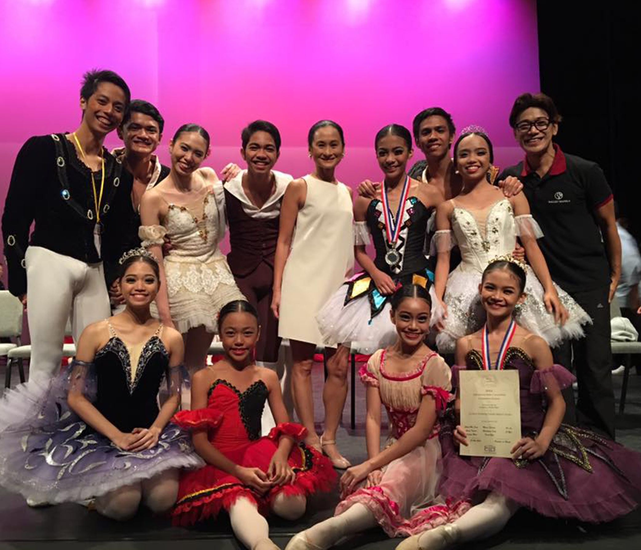 Shaira Comeros (front, rightmost) was named Most Promising Female Dancer Award atthe 2016 Asian Grand Prix. With her in the photo are 11 of the 18-member BM delegation who also reached the finals: (standing, from left) Rodney Catubay, Joshua Encisco, Danielle De Guzman, Alvin Dictado, artistic director Lisa Macuja-Elizalde, silver medalist Nicole Barroso, Raymond Salcedo, Lyssa Apilado, and co-artistic director Osias Barroso; (seated, from left) Ana Andes, Loraine Gaile Jarlega and Ashley Salonga.