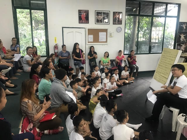 Ballet Manila rehearsal master Jonathan Janolo leads an orientation meeting with the new PBF scholars and their parents.