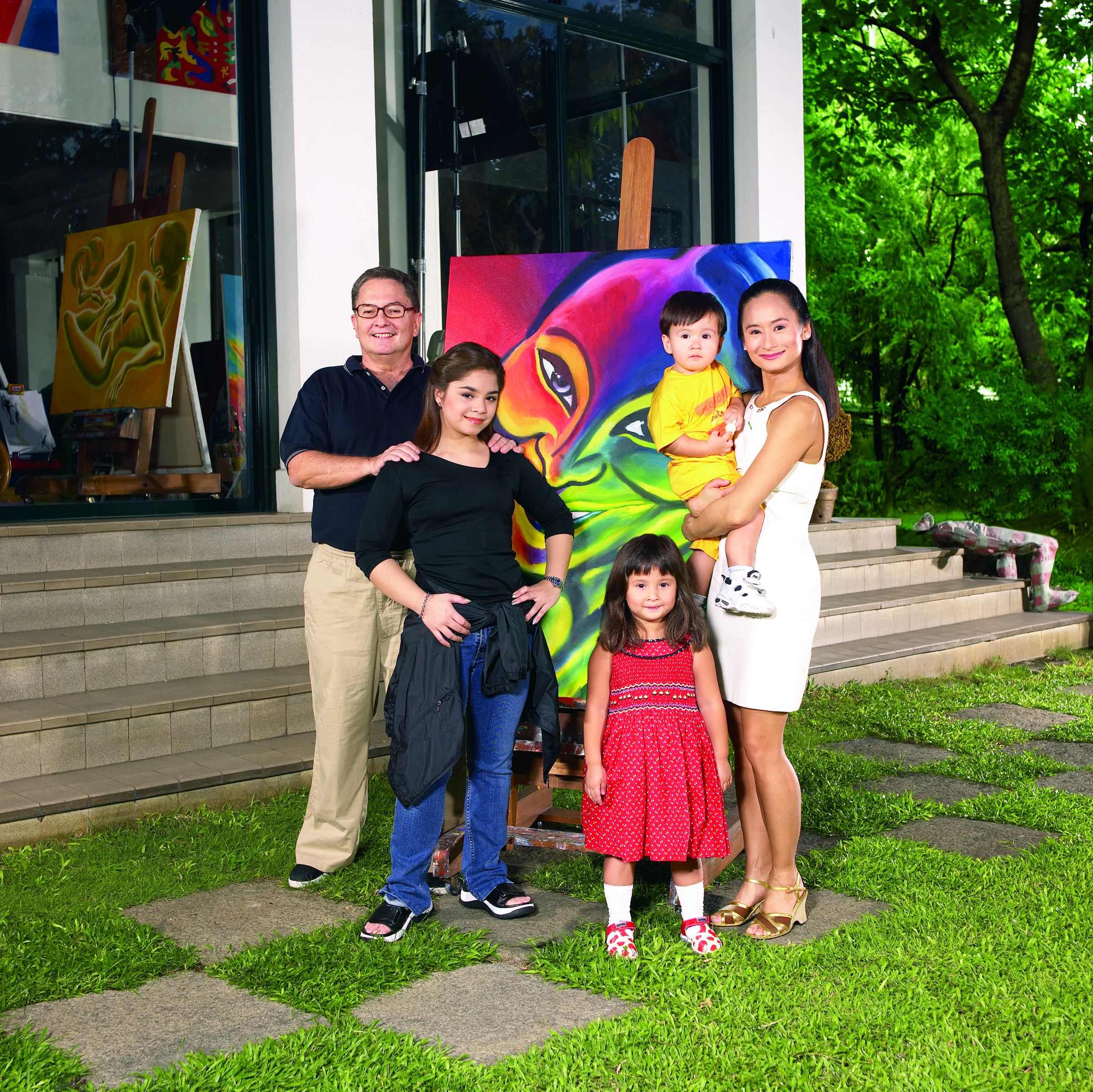 Fred has painted many works depicting Lisa, including the one shown in this family photo taken in 2002. With the couple are their children Sasha, Missy and Manuel.