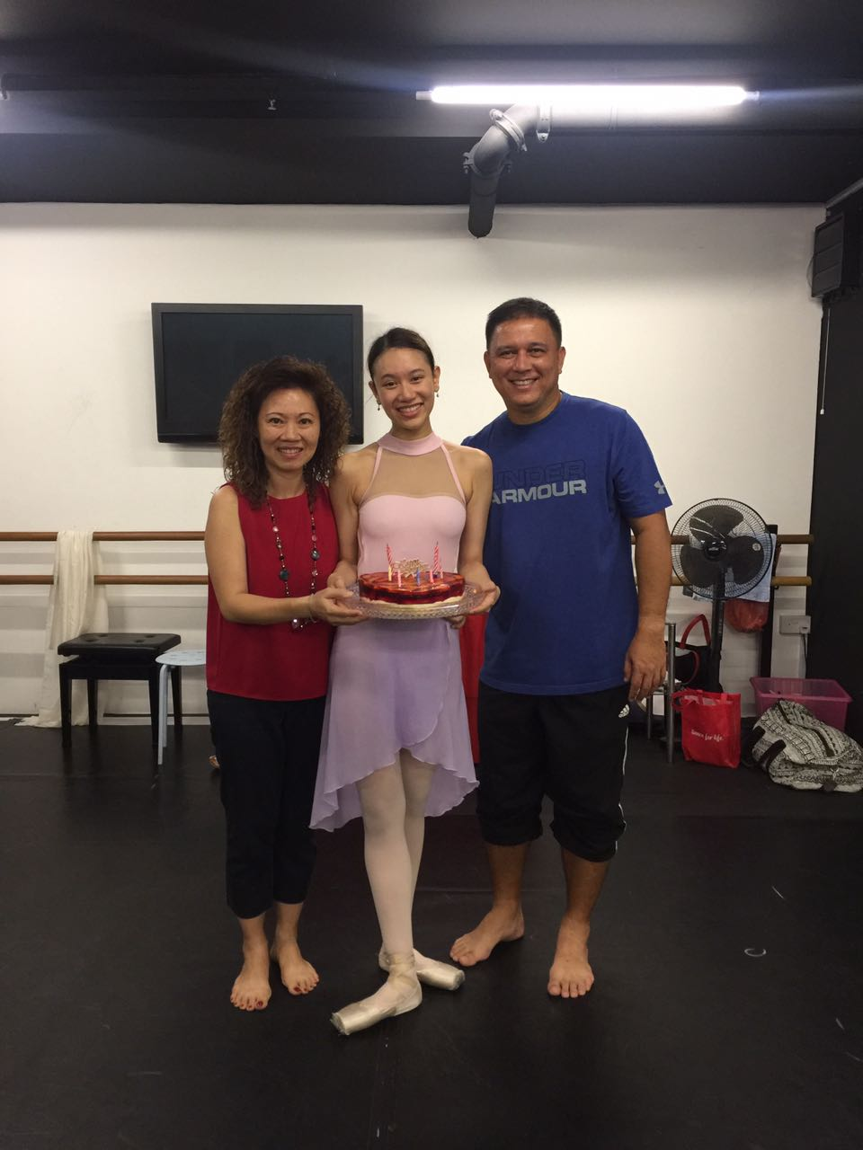 Abigail gets a surprise birthday cake from aunt June Lee, director of The School of Dance, Singapore, and her husband Jeff Macpherson.