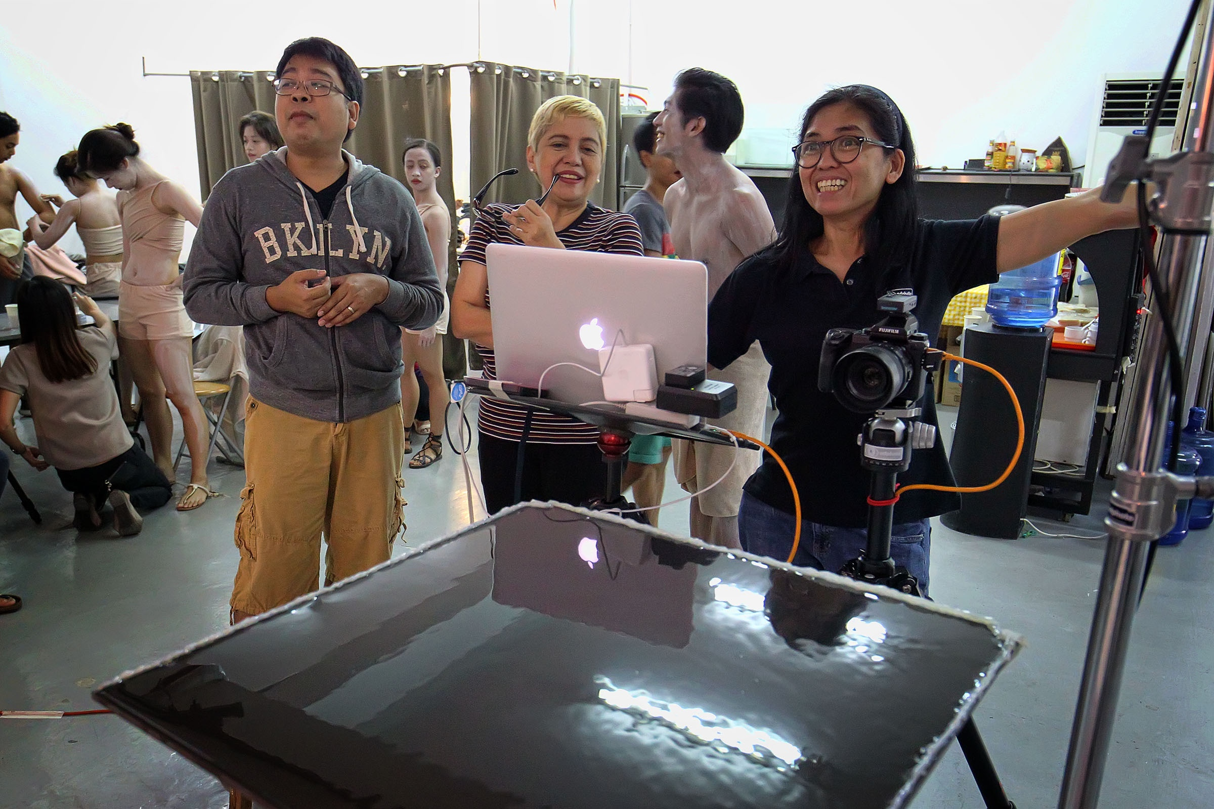 Master photographer G-Nie Arambulo behind the scenes with movement choreographer Jonathan Janolo and project manager Angela Ureta.