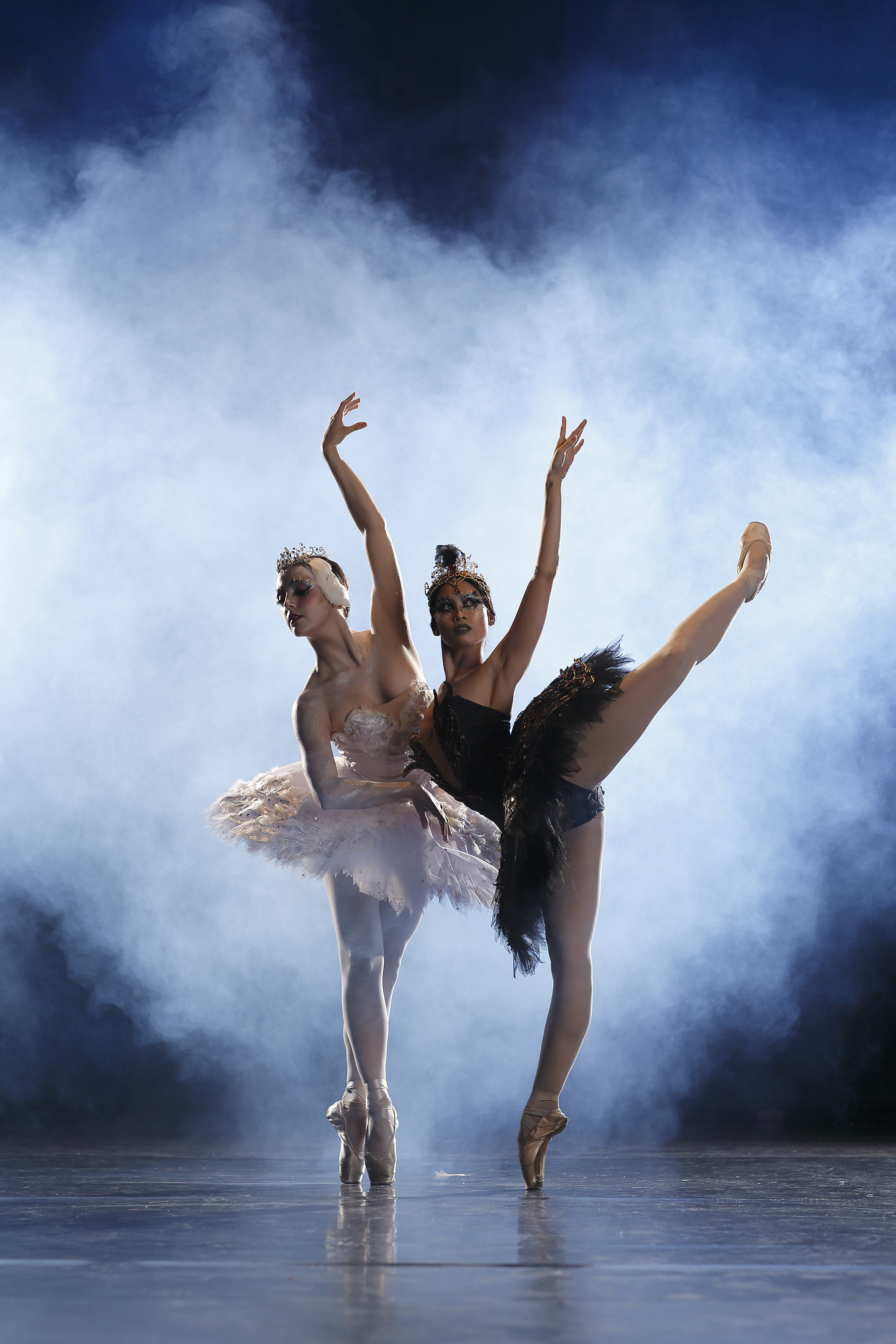 Principal dancer Katherine Barkman and soloist Joan Emery Sia debut in the dual role of Odette and Odile in Ballet Manila's 2017 production of the full-length    Swan Lake   . Photo by Ocs Alvarez