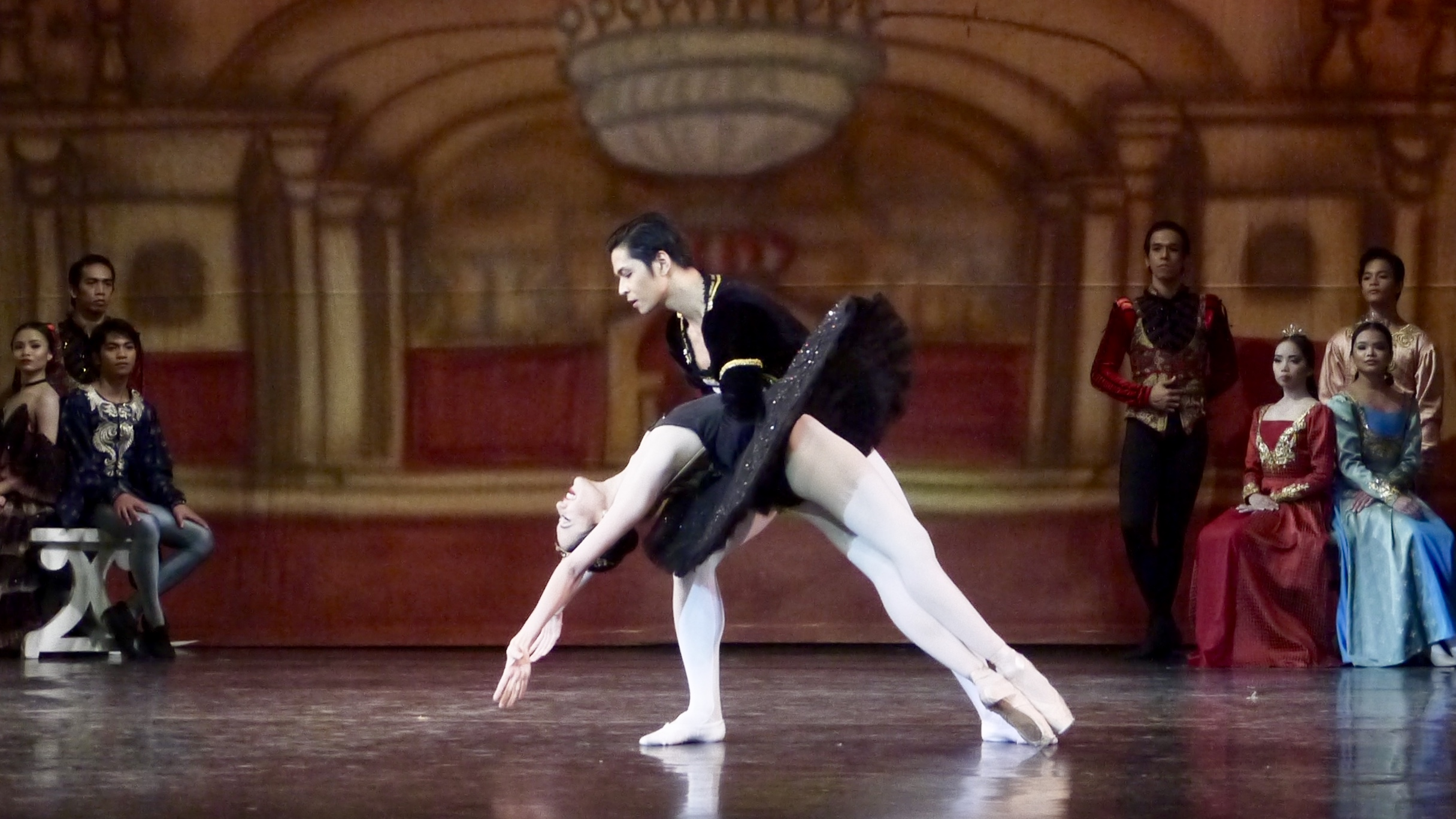 Abigail Oliveiro as Odile, the Black Swan, and Mark Sumaylo as Prince Siegfried. Photo by Giselle P. Kasilag
