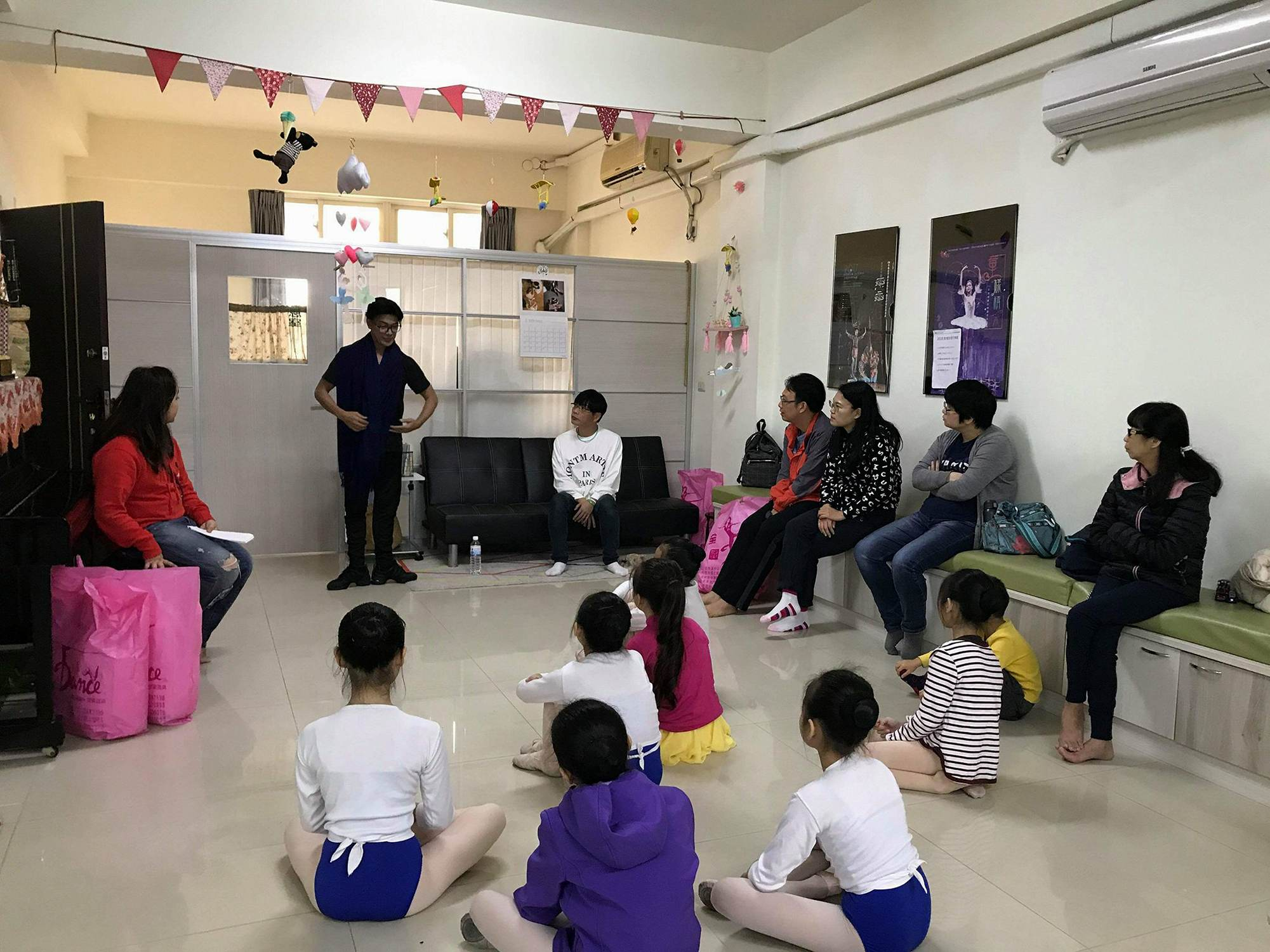 Ballet Manila co-artistic director Osias Barroso conducts one of the classes, as some parents also listen in, at the Zhongli Youth Ballet.