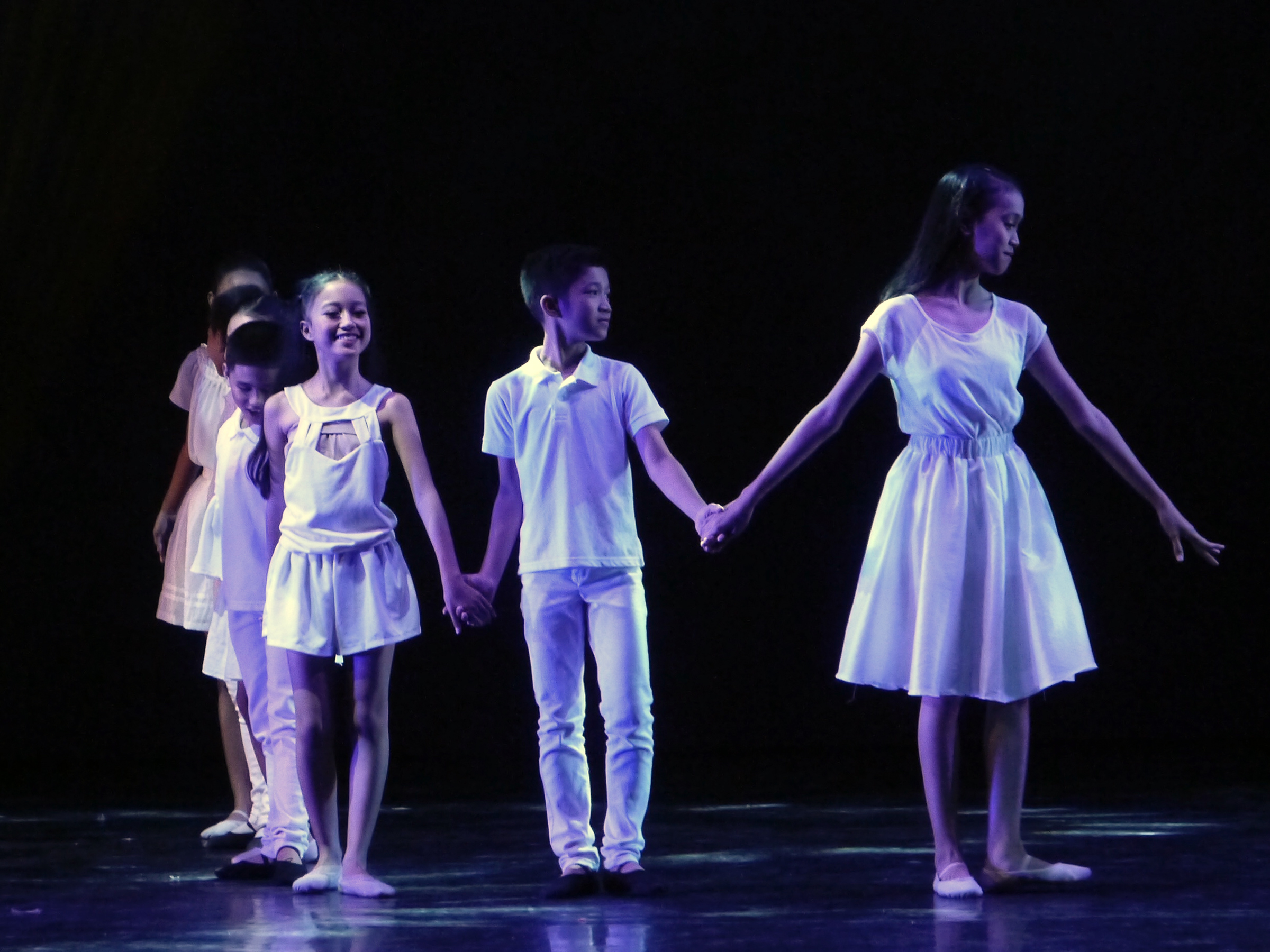 Gian (left, foreground) and other Project Ballet Futures scholars danced in    Ballet & Ballads   , in a number sung by pop singer Christian Bautista. Photo by Giselle P. Kasilag