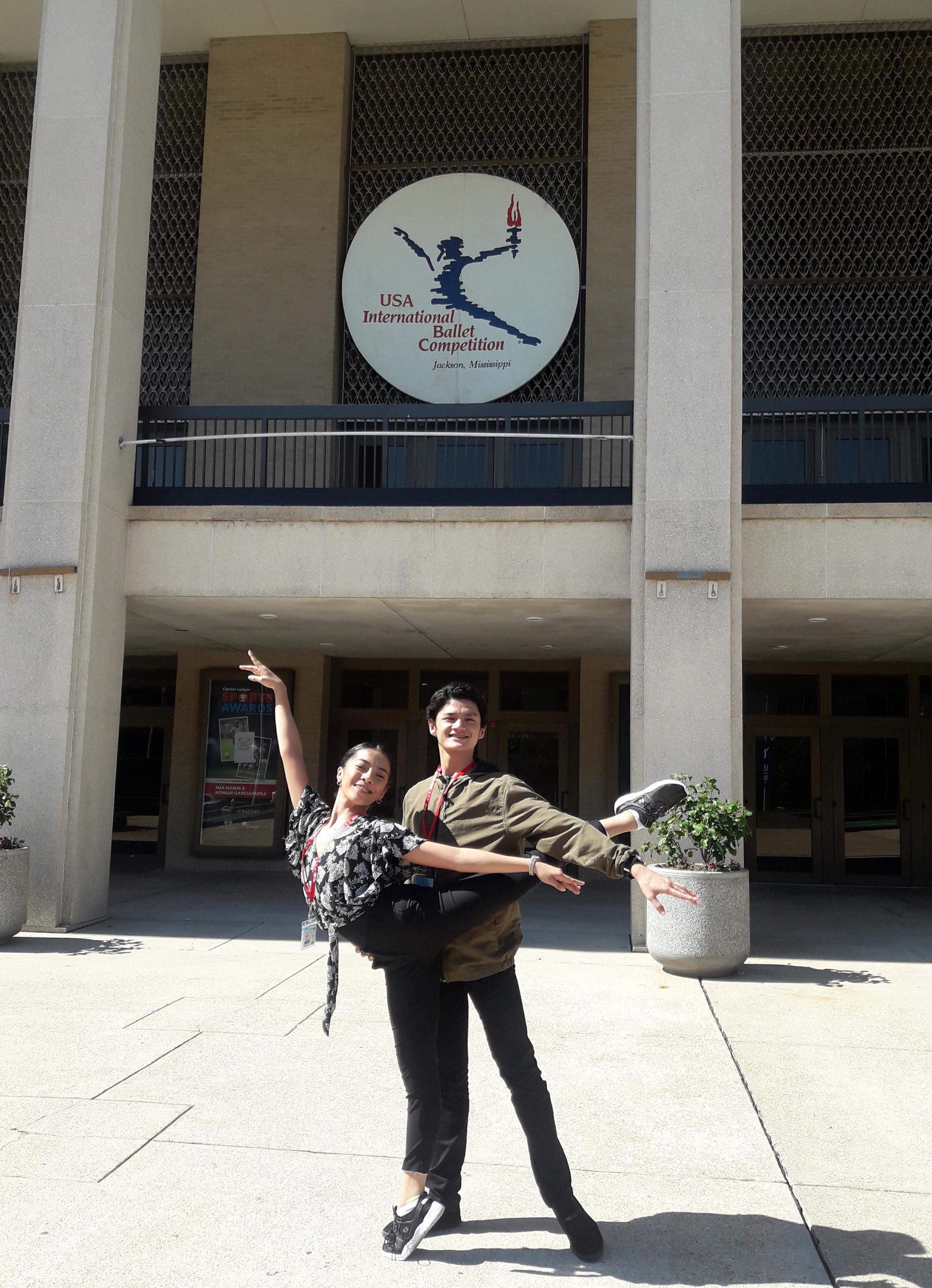 In Jackson at last: Nicole Barroso and Joshua Enciso strike a ballet pose in front of the Thalia Mara Hall, venue of the 11th USA International Ballet Competition. Photo by Osias Barroso.