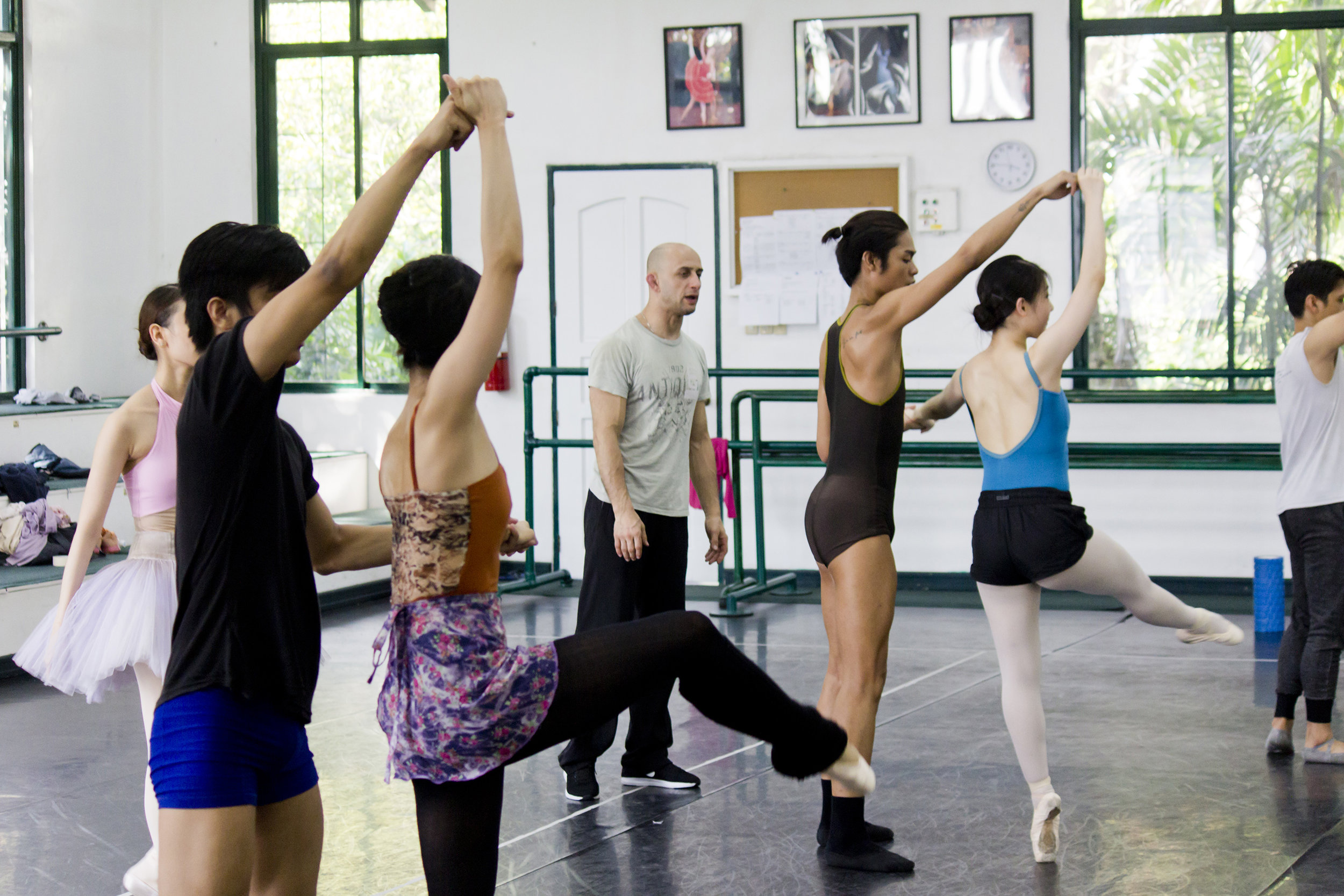 George Birkadze (center) rehearses    Imperial    with Ballet Manila dancers. He describes the piece as having lots of strong jumps, difficult partnering, and fast movement. Photo by Jimmy Villanueva