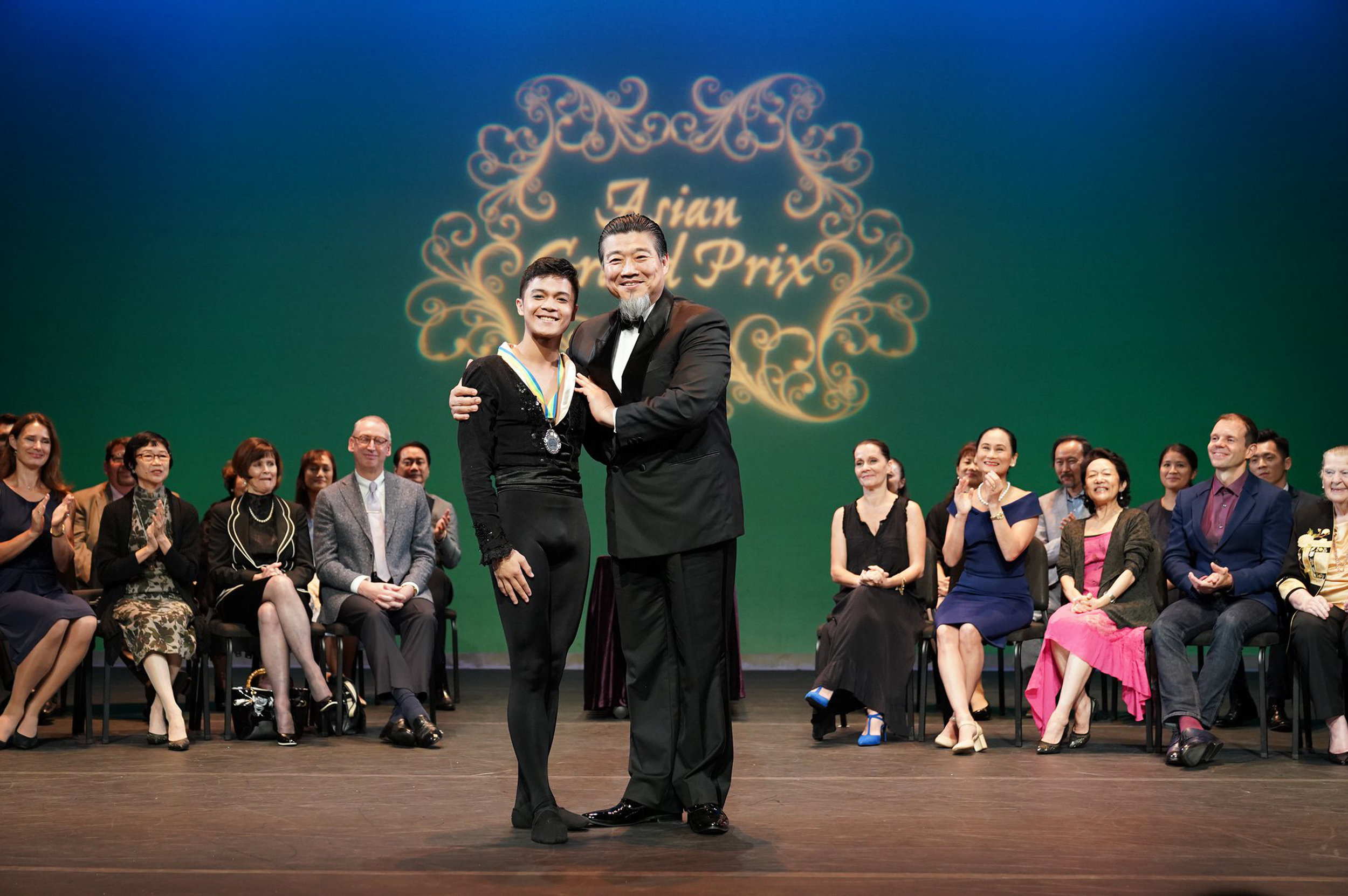 Rafael Perez receives his Senior silver medal from Asian Grand Prix juror Jae Keun Park in last August's awarding program in Hong Kong. He tied with Japanese ballerina Yuko Nojo. Photo courtesy of Asian Grand Prix