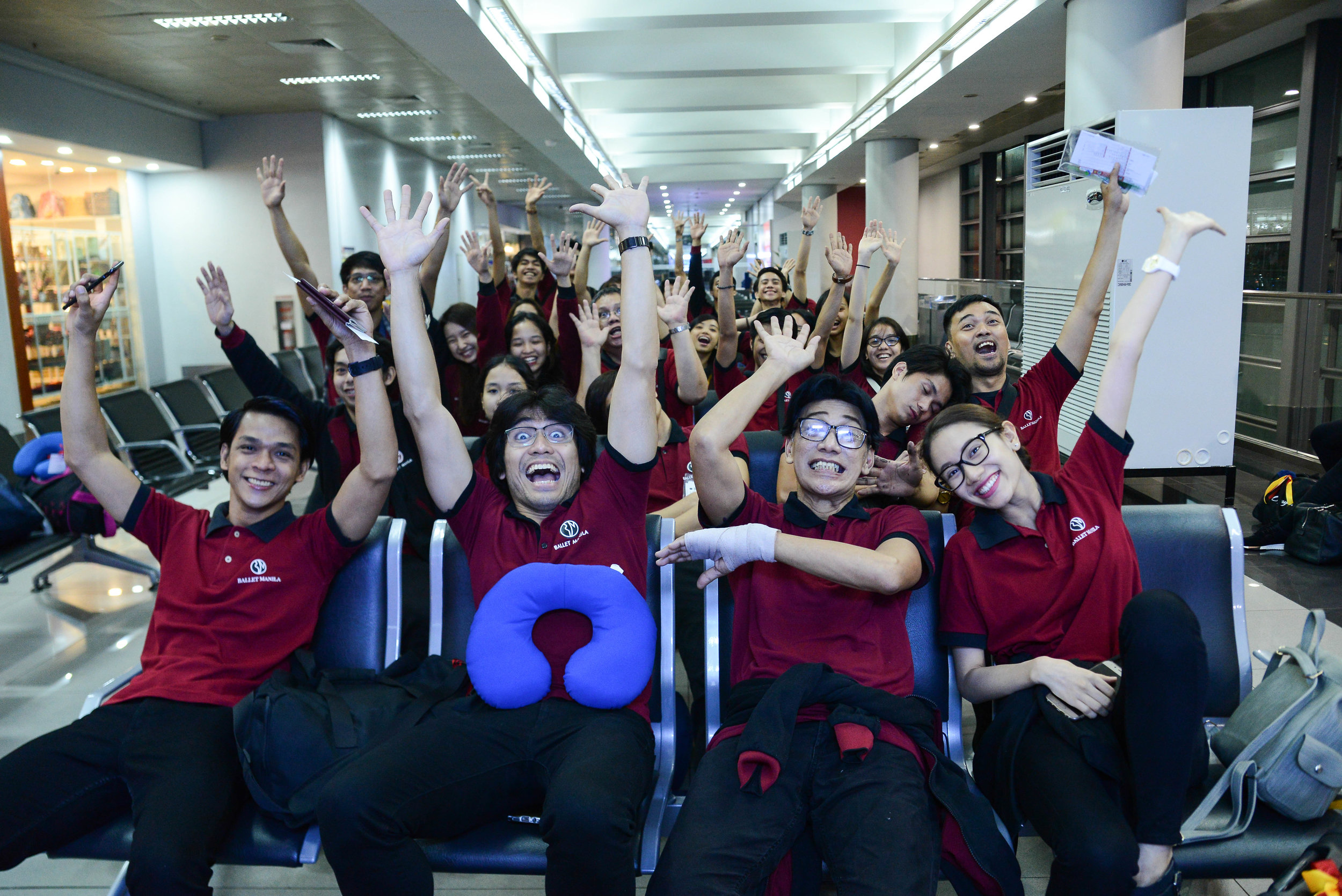 The group is in an upbeat mood at the airport just before leaving Manila. Photo by Mark Sumaylo