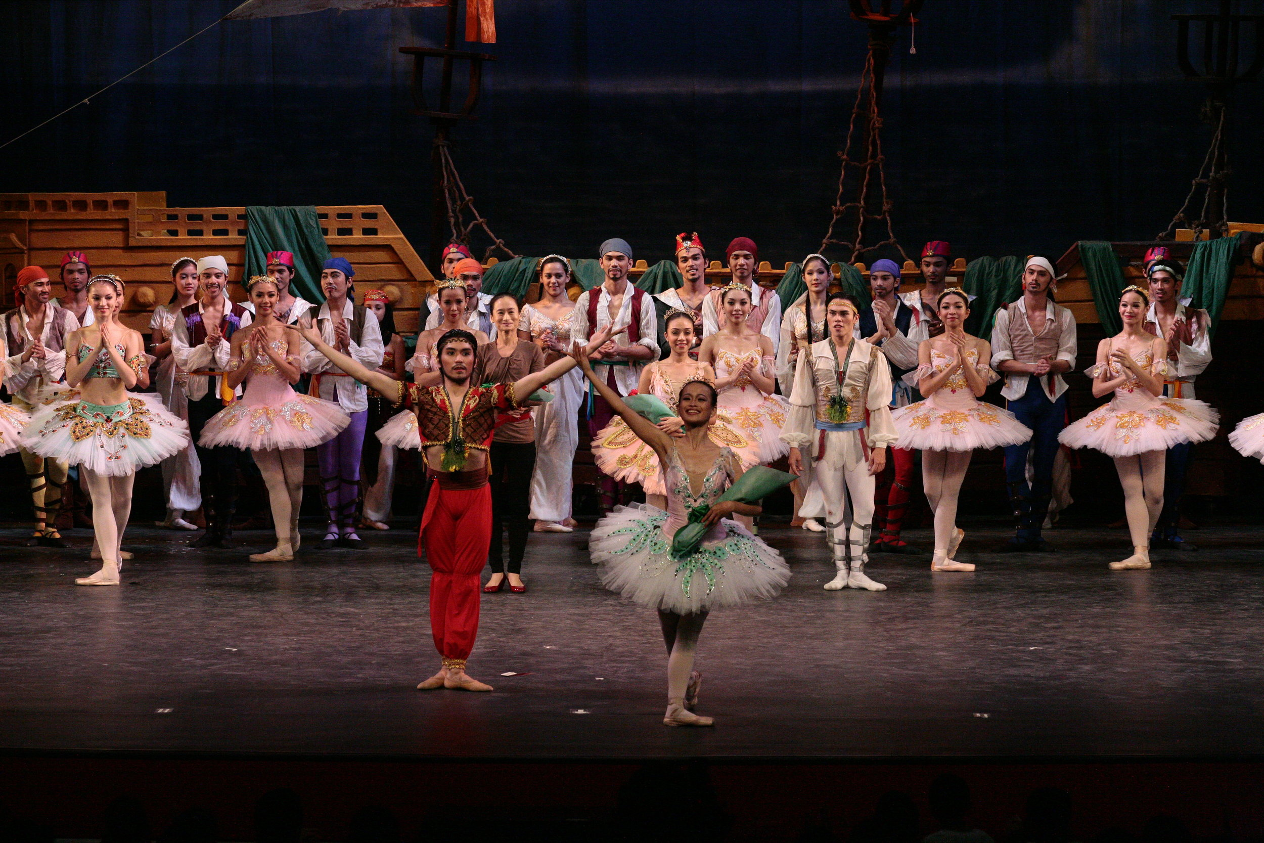 As  Le Corsaire 's slave trader Lankadem in 2010, Romeo takes a bow along with Yanti Marduli as Gulnara and the rest of the cast. Photo by Ocs Alvarez