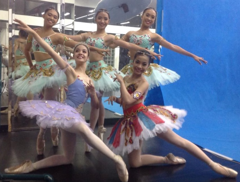 Taking a souvenir shot in their tutus before Ballet Manila's  Must Dance  recital in December 2015: Nicole (as  Le Corsaire 's Gulnara) poses with Marinette Franco (left) and (back, from left) Abigail Bonifacio, Denise Elizon and Kayla Coseteng.