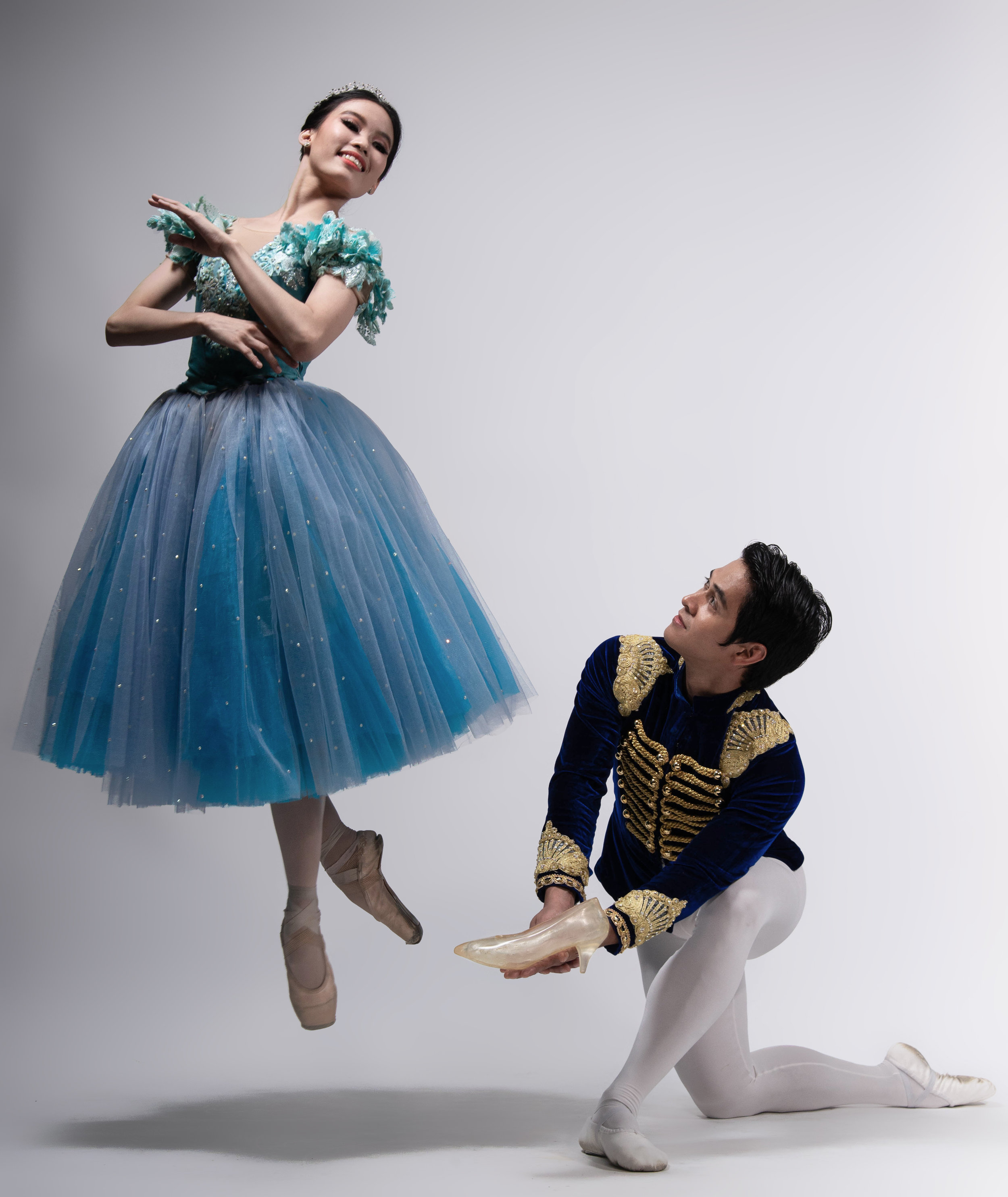 As Cinderella, Joan Emery Sia floats on air when her prince (Rudy De Dios) presents her with the glass slipper she left behind at the ball. Photo by MarBi Photography