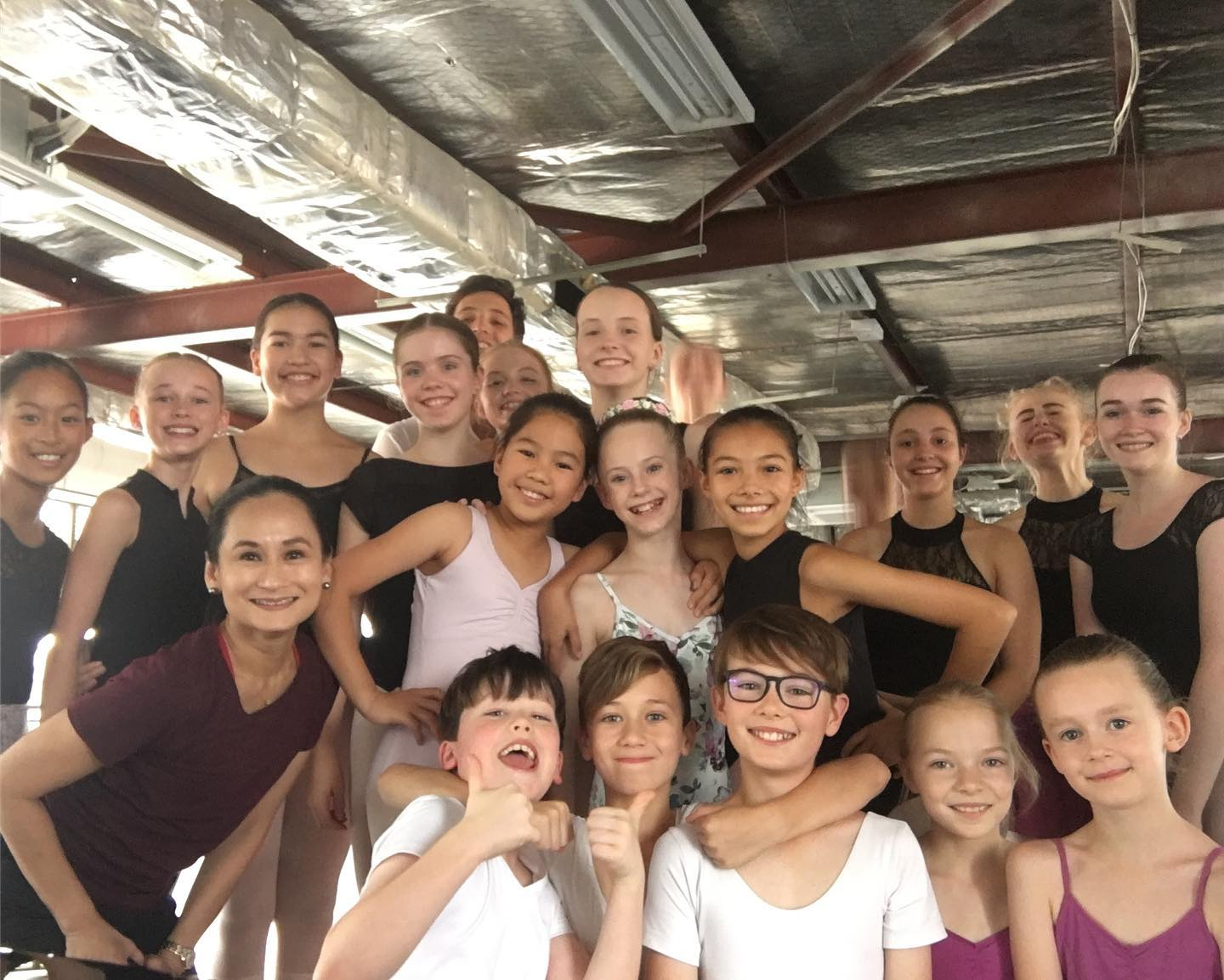 Ballet Manila artistic director Lisa Macuja-Elizalde (front, leftmost) poses for a group photo with some of her students during a summer workshop in Canberra, Australia.