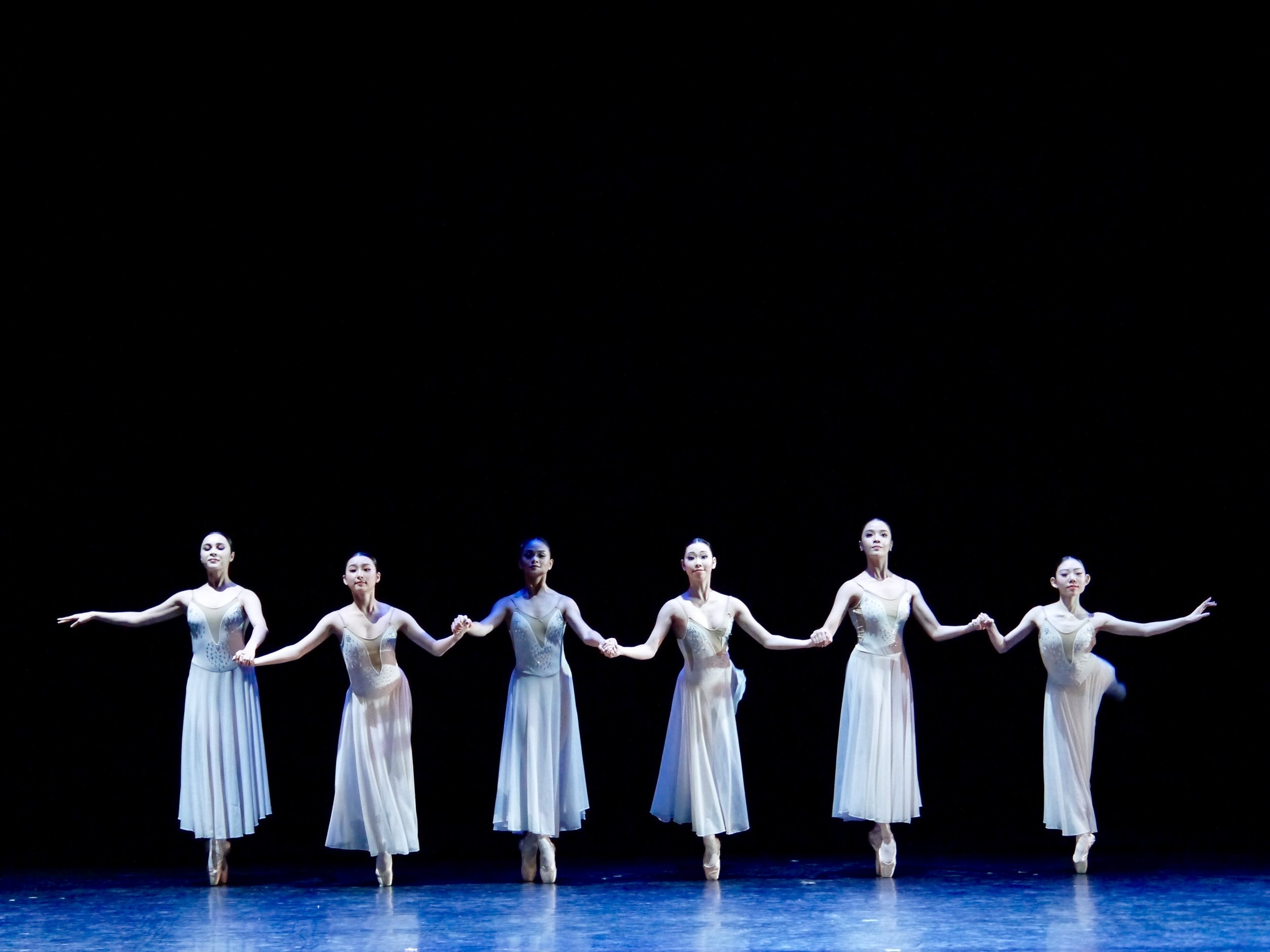 In Ballet Manila's season-opener,  Iconic 1.0,  Kotomi Narai (rightmost) danced the challenging  Sotto Voce , a choreography requiring the ballerinas to be on pointe for practically the whole number. Photo by Giselle P. Kasilag