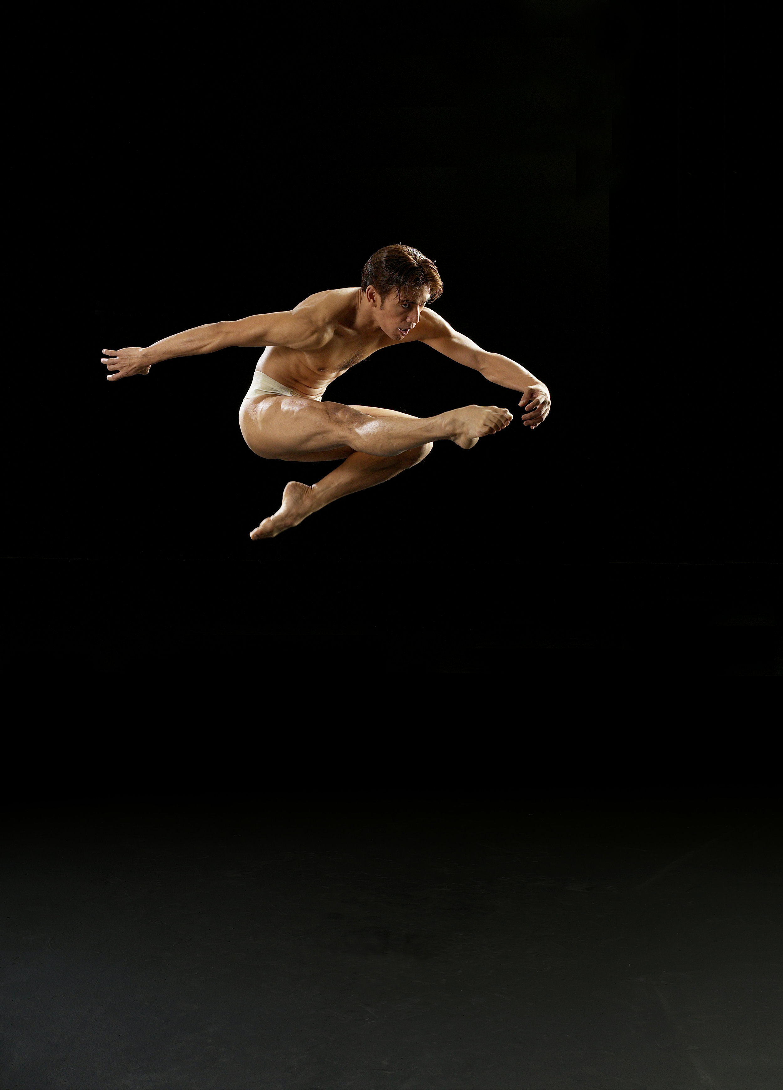 """This stunning portrait of Osias """"Shaz"""" Barroso, taken by G-nie Arambulo, shows the dancing form that entranced Filipino ballet audiences for years. Today, as Ballet Manila's co-artistic director and rehearsal master, he is a mentor to a new generation of dancers."""