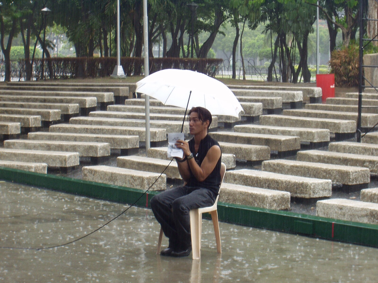 The show must go on! Shaz sits in the rain as he conducts rehearsals for a Ballet Manila engagement at the Rizal Park Open-Air Auditorium. Photo by Jimmy Villanueva