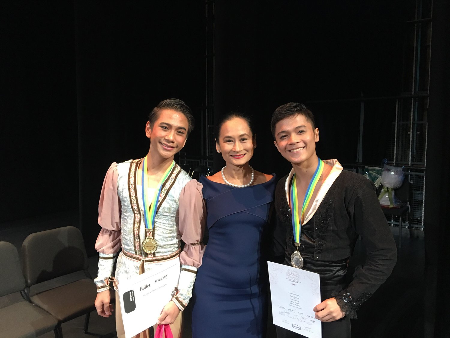 Ballet Manila's Brian Sevilla (left) won gold in Junior B and Rafael Perez (right) the silver in Senior at the 2018 Asian Grand Prix in Hong Kong. With them is Ballet Manila artistic director Lisa Macuja-Elizalde.
