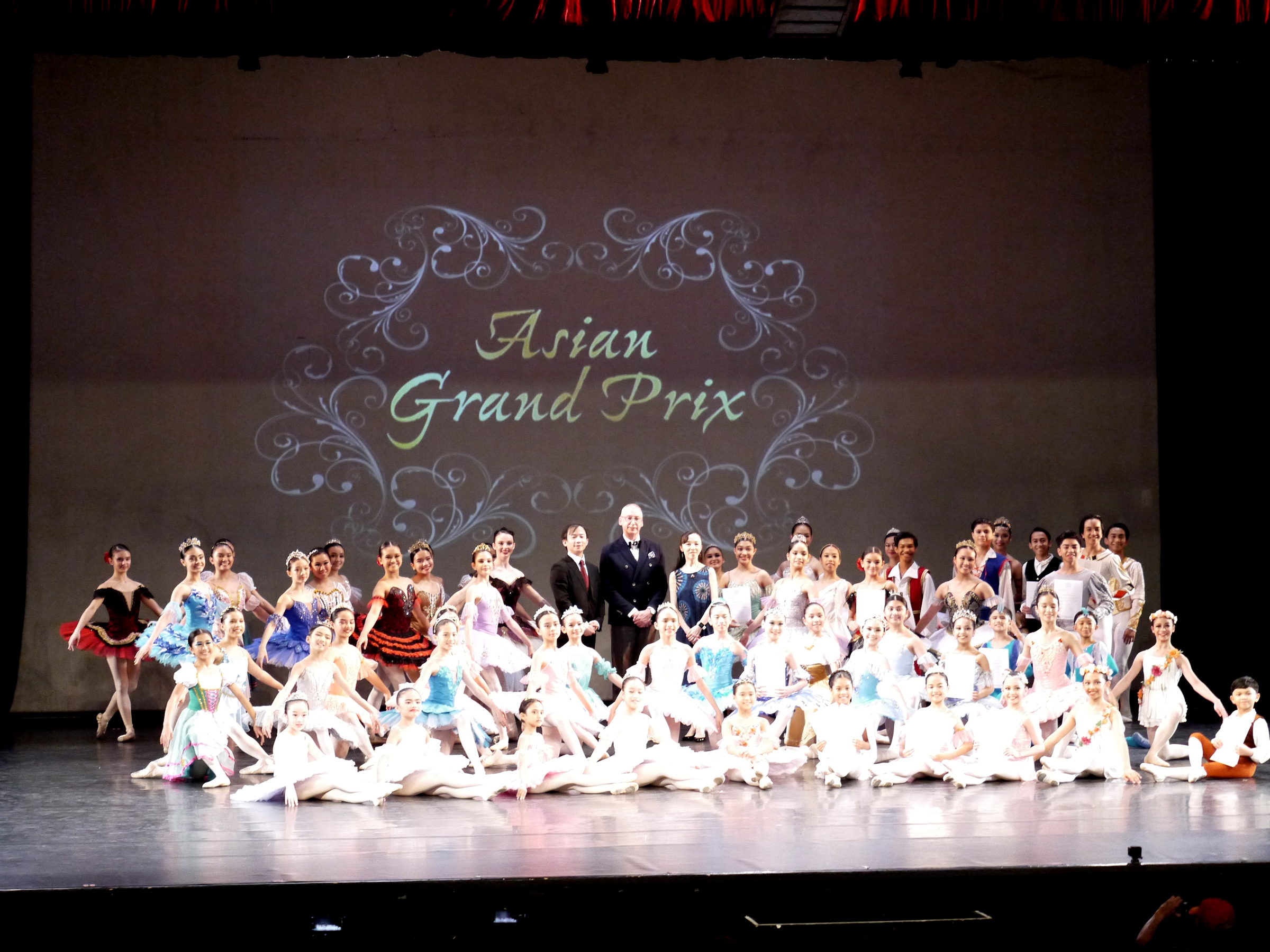 The 57 participants in the Asian Grand Prix Manila Regional Competition with the AGP Regional Jury (standing, center) composed of: So Hon Wah, chairman of AGP; Garry Trinder, director of the New Zealand School of Dance; and Eriko Ochiai, former principal dancer of the Hong Kong Ballet. Photo by Giselle P. Kasilag