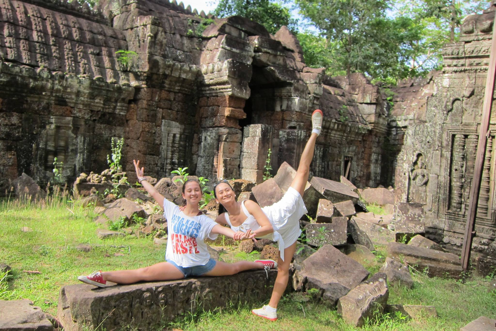 In Cambodia in 2013, mother and daughter demonstrate their flexibility with splits executed amid the ruins of the Angkor Wat. Photo courtesy of Missy Macuja-Elizalde