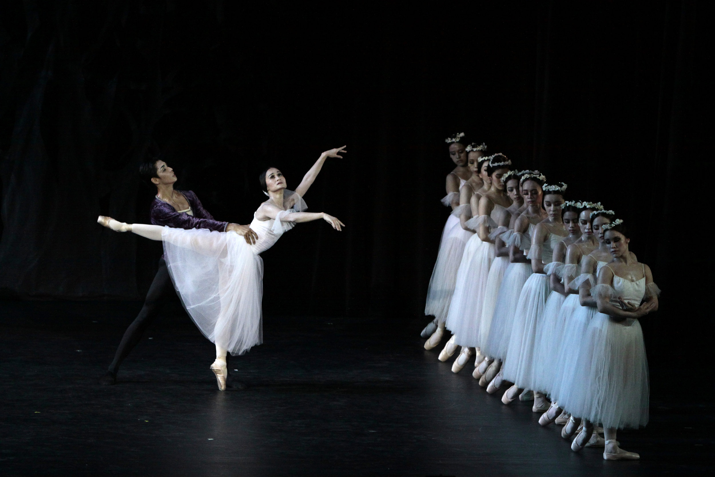 A poignant scene from Giselle is recreated by Nazer Salgado and Lisa Macuja-Elizalde, together with the Ballet Manila corps, in the company's 2010 staging of the dance classic. Photo by Ocs Alvarez from the Ballet Manila Archives collection