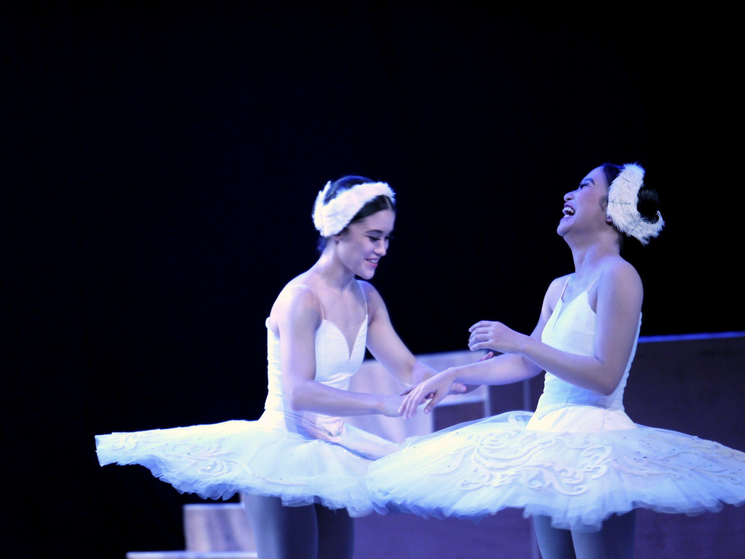 The camera caught this light-hearted moment between principal dancer Jasmine Pia Dames and former soloist Tiffany Chiang-Janolo while on a break during the grueling technical dress rehearsals for  Swan Lake  (2017). Photo by Giselle P. Kasilag