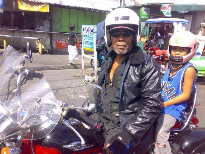 """A young Rudy De Dios gets a ride on his father's motorcycle. Rudy has always thought of his father Albano as """"badass"""", having a nickname like Django."""