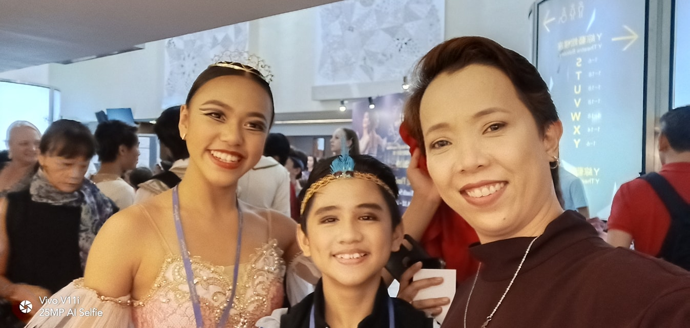 Teacher Eileen Lopez (right) with Loraine Gaile Jarlega and Juan Angelo De Leon shortly before the two dancers competed in their respective finals. Photo courtesy of Eileen Lopez