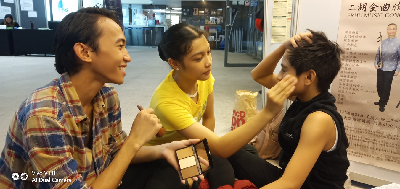 Semi-finalists Eduardson Evangelio and Monique Valera help Juan Angelo De Leon with his make up for his finals in Pre-Competitive B. Photo courtesy of Eileen Lopez