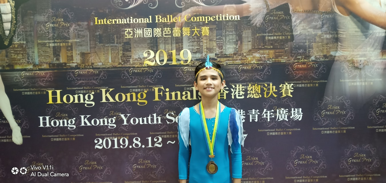 A newcomer to competing, Juan Angelo De Leon wears his Asian Grand Prix bronze medal after the awarding program in Hong Kong. Photo courtesy of Eileen Lopez