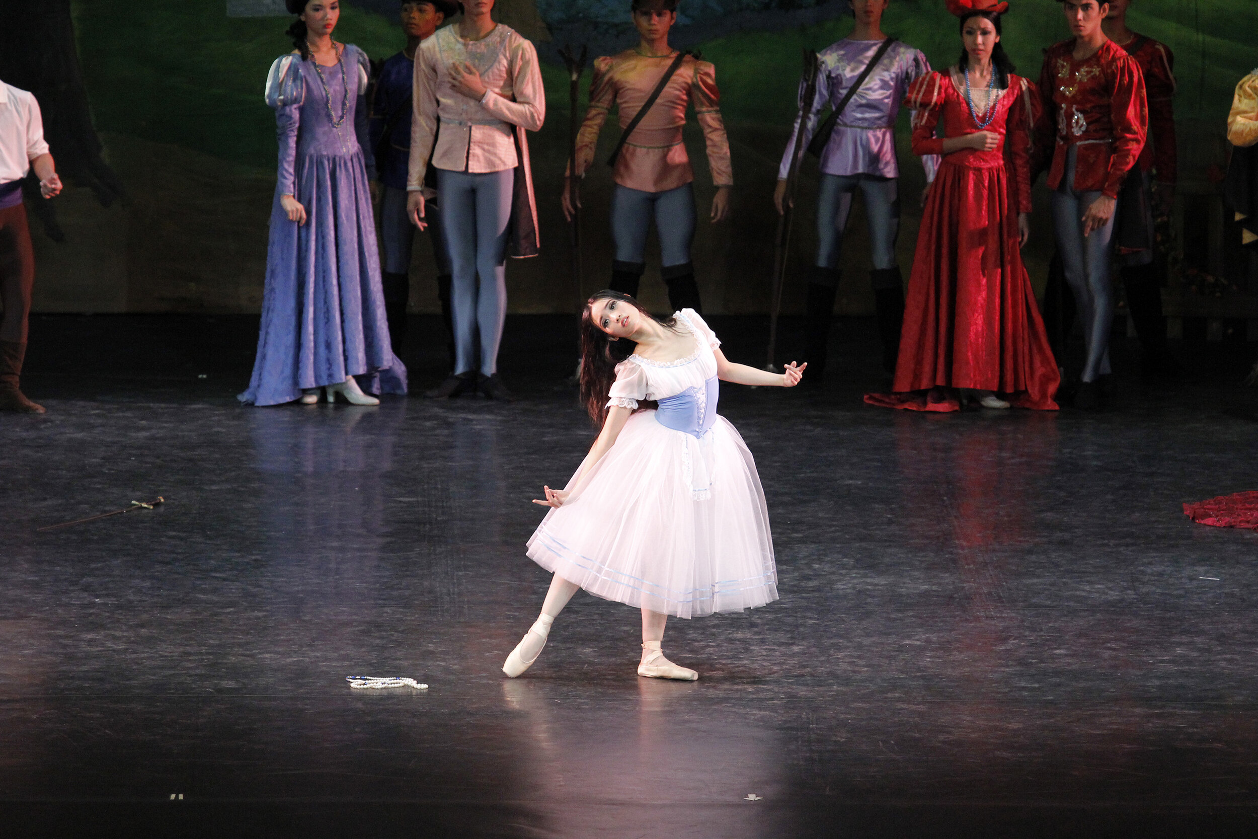 Joan Emery Sia as Giselle descends into madness upon learning of Albrecht's deception. Photo by Ocs Alvarez