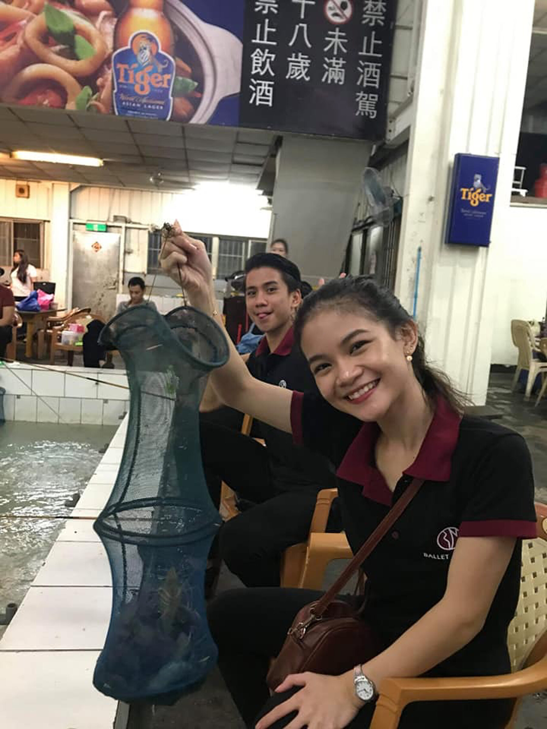 Shaira shows off her catch of shrimp for dinner in a local restaurant.