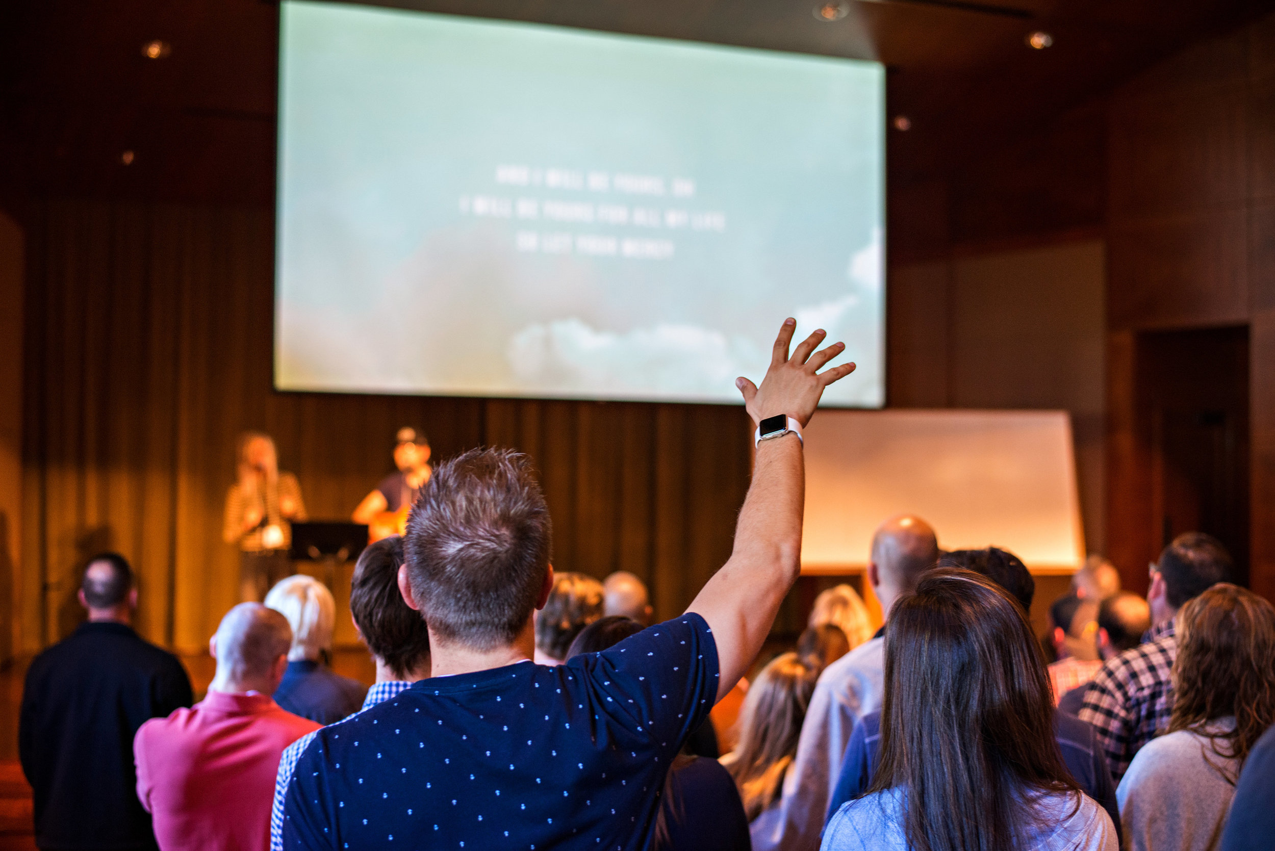 A shot captured by Allen and Carol Photography. Love seeing my man worship the Lord! And now, we can see what we look like from the back of our heads too. :)