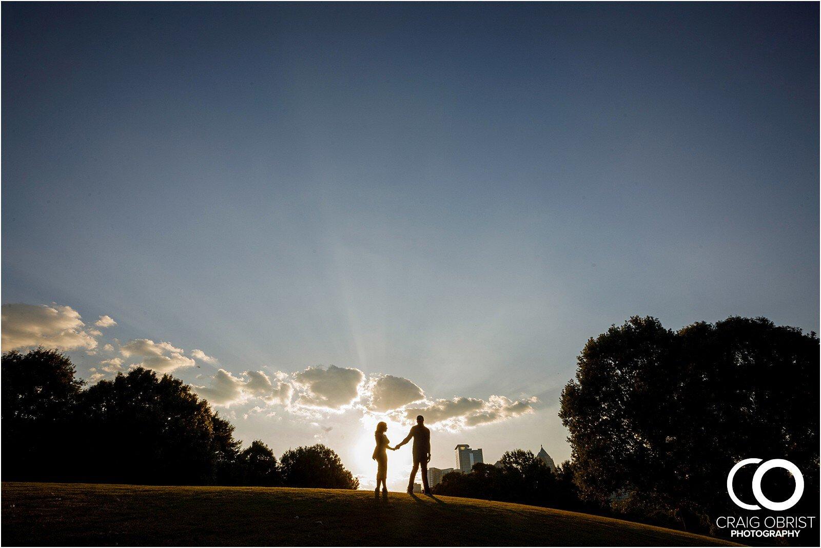 Piedmont Park Merecedes Benz Stadium Atlanta Skyline Enagagement Portraits_0011.jpg