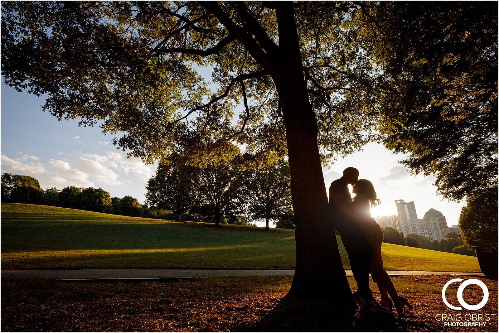 Piedmont Park Merecedes Benz Stadium Atlanta Skyline Enagagement Portraits_0010.jpg
