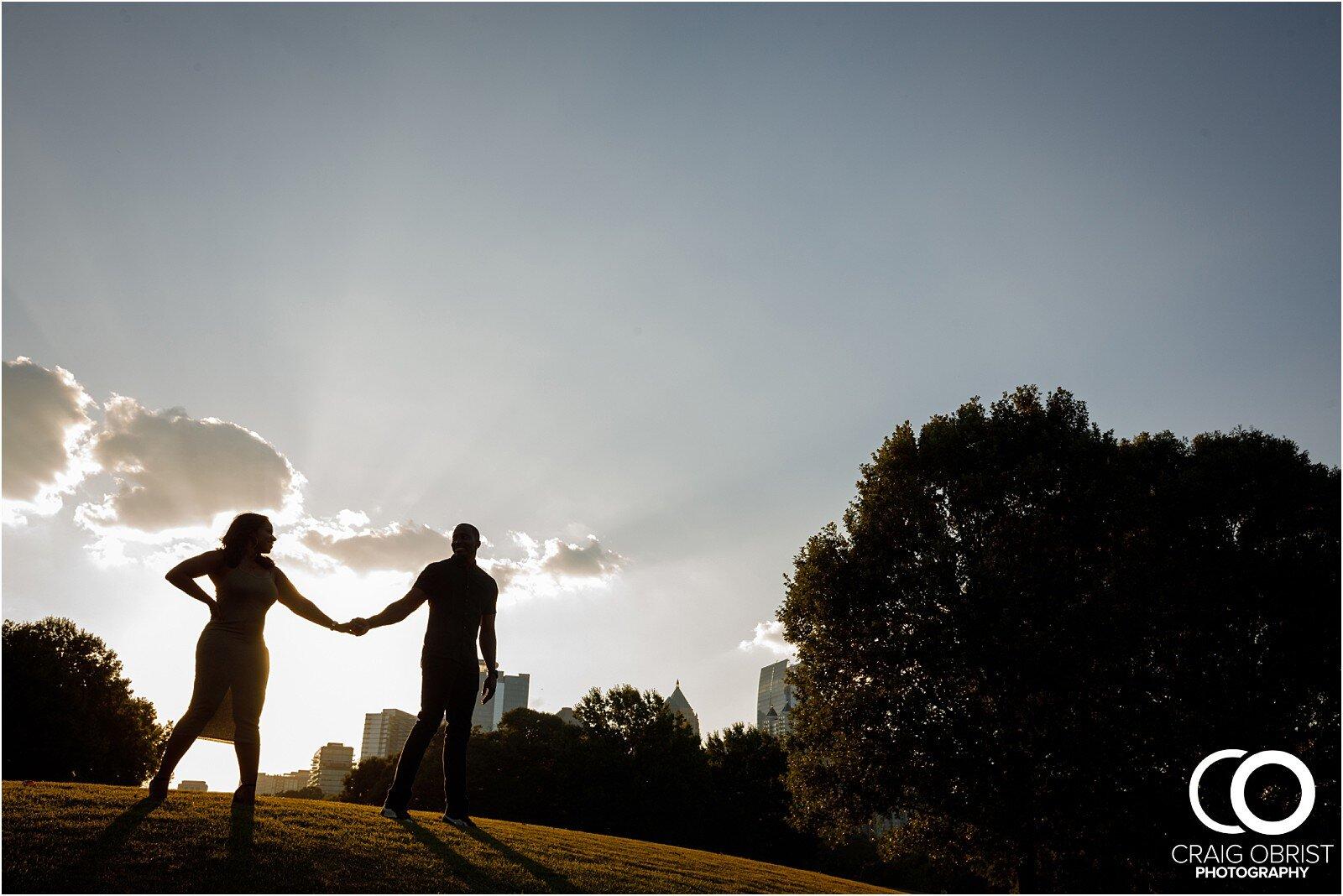 Piedmont Park Merecedes Benz Stadium Atlanta Skyline Enagagement Portraits_0012.jpg