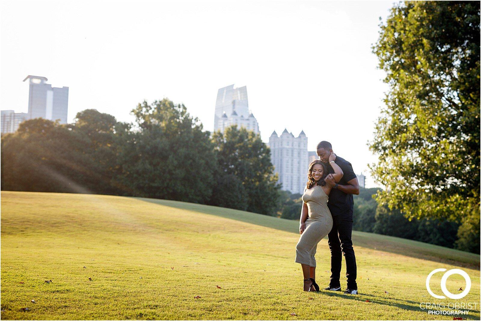 Piedmont Park Merecedes Benz Stadium Atlanta Skyline Enagagement Portraits_0016.jpg