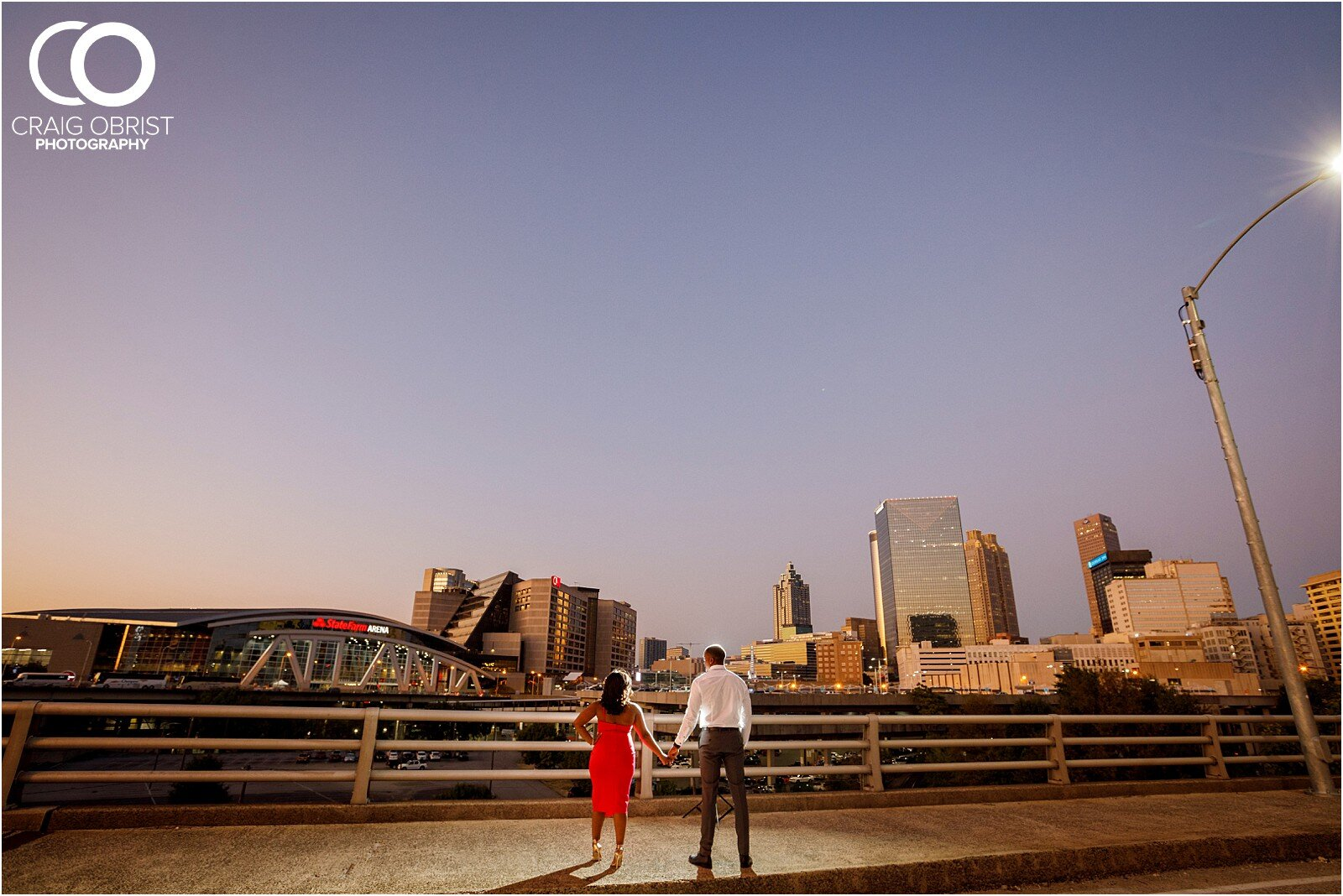 Piedmont Park Merecedes Benz Stadium Atlanta Skyline Enagagement Portraits_0029.jpg