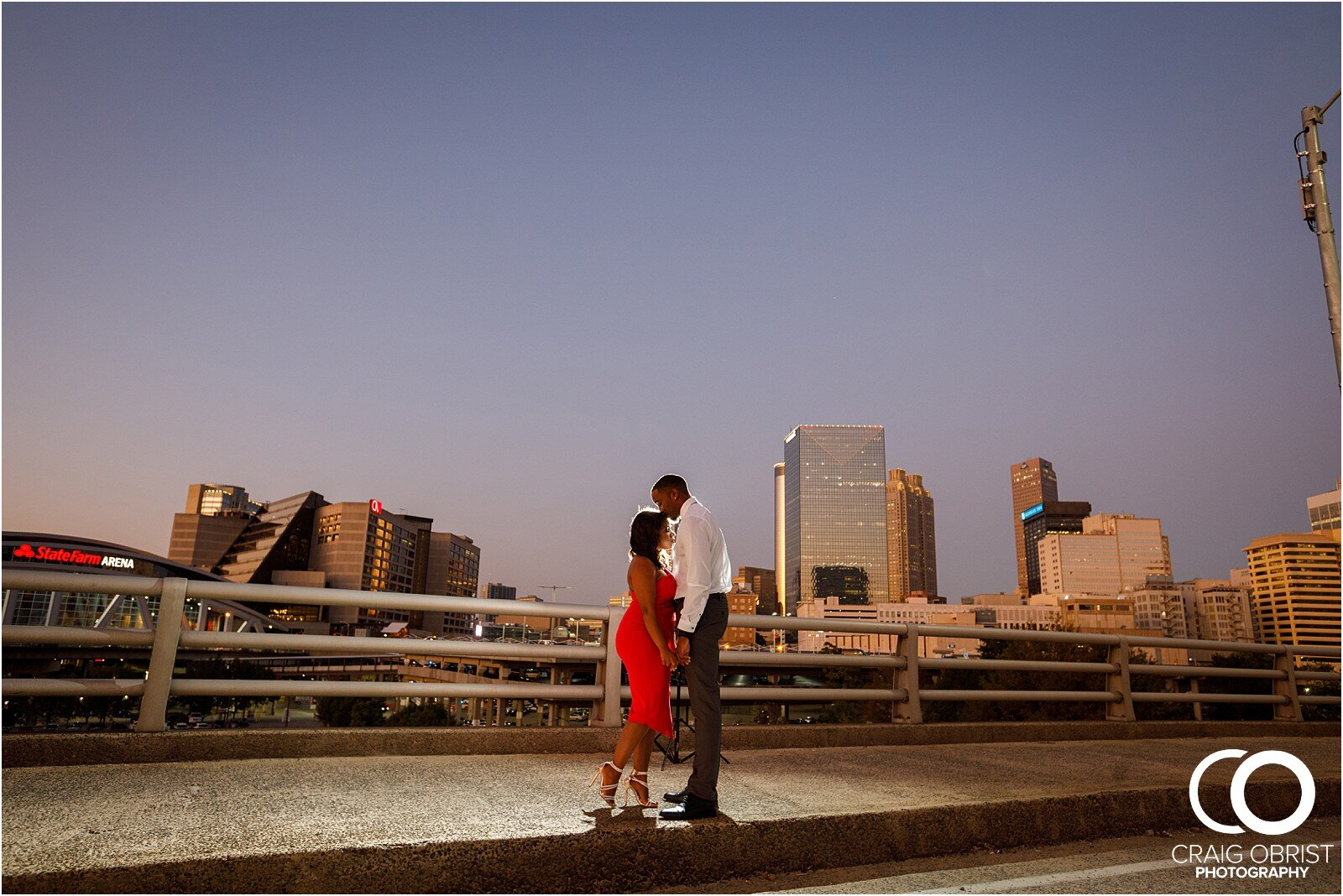 Piedmont Park Merecedes Benz Stadium Atlanta Skyline Enagagement Portraits_0030.jpg