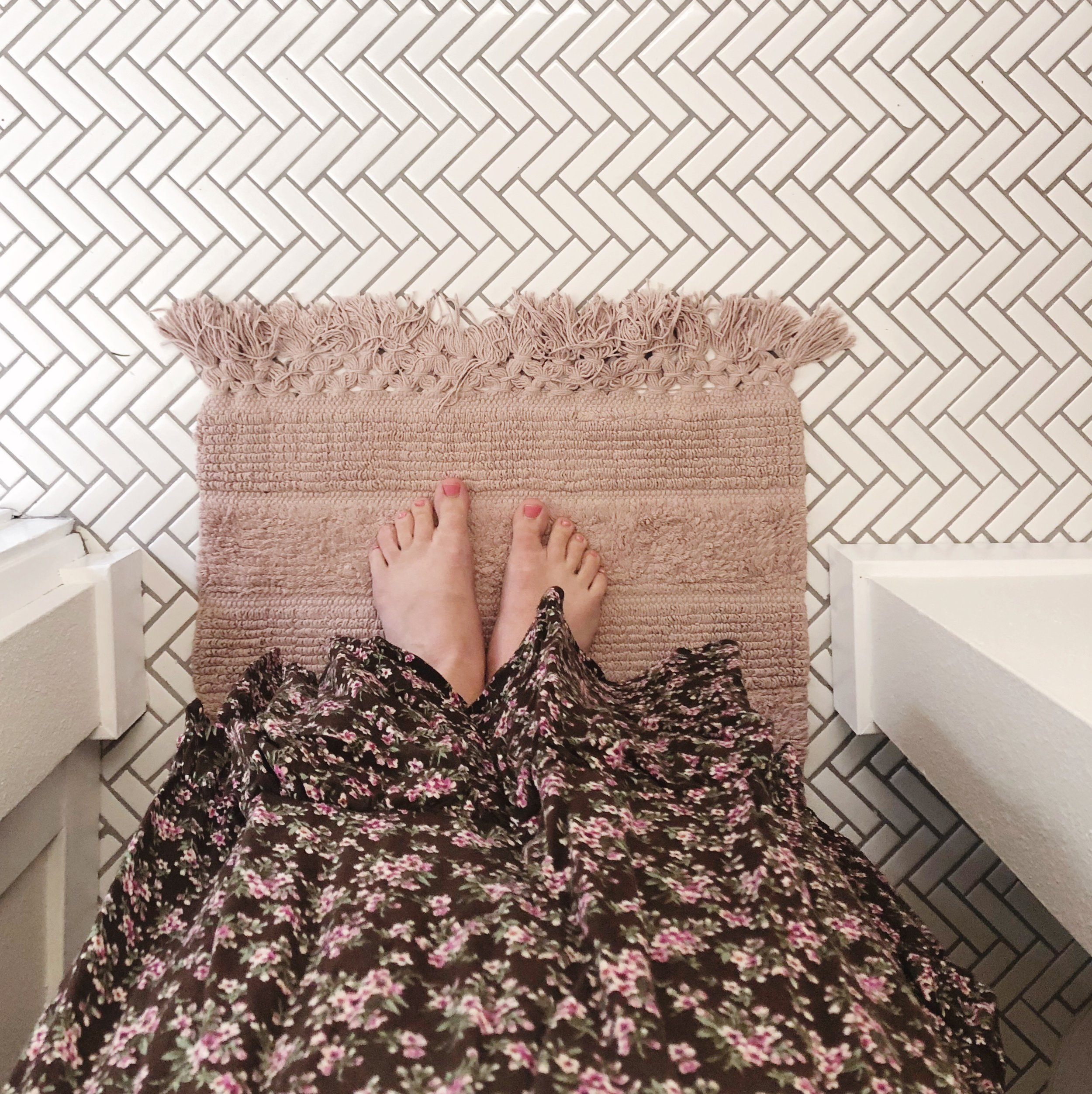 herringbone tile bathroom floor